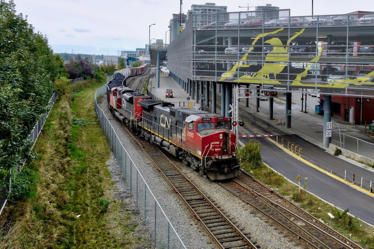 Canadian National Railway locomotive 2595 crosses Front St., New Westminster, B.C.