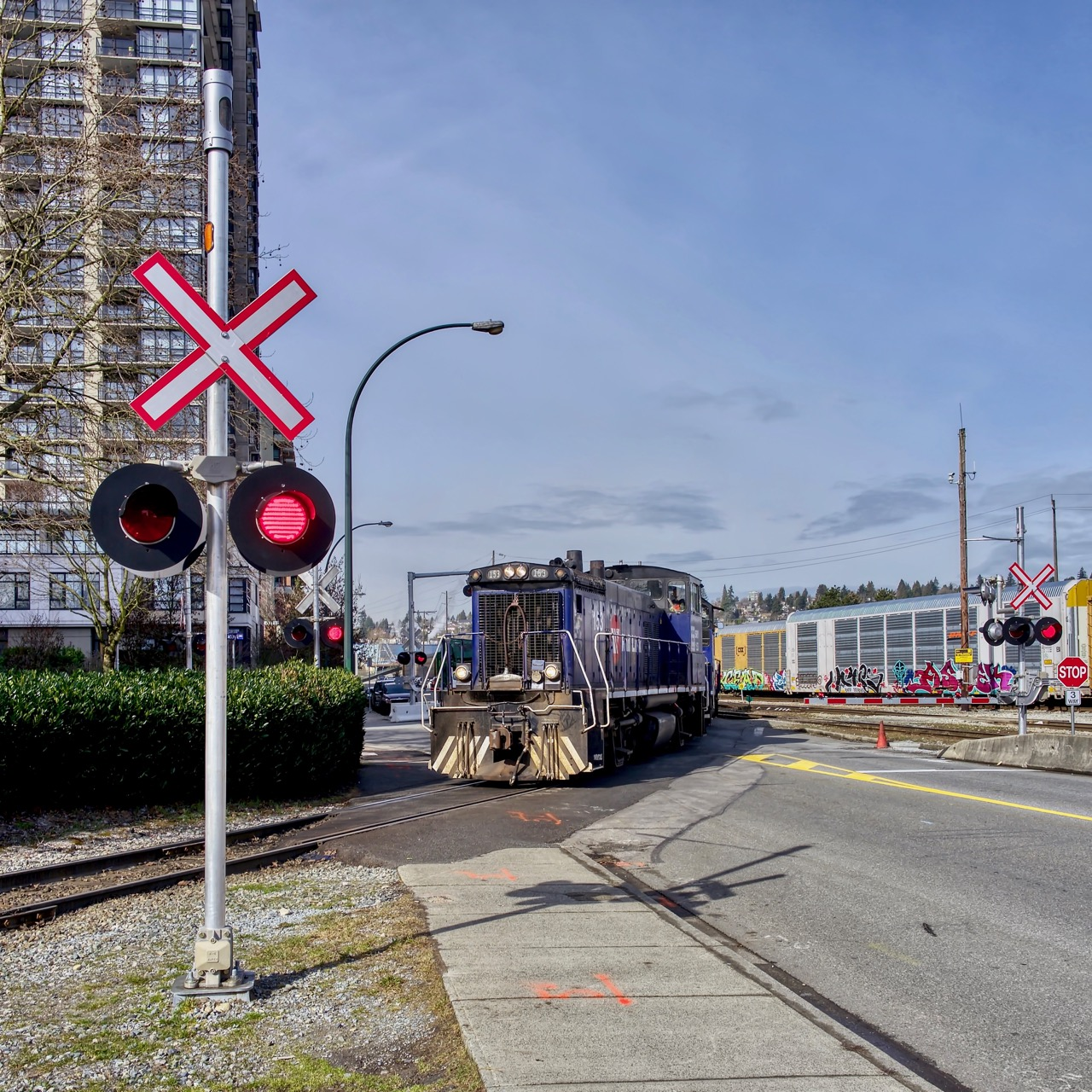 Southern Railway of B.C. (SRY) locomotive 153 crosses street in New Westminster, B.C.