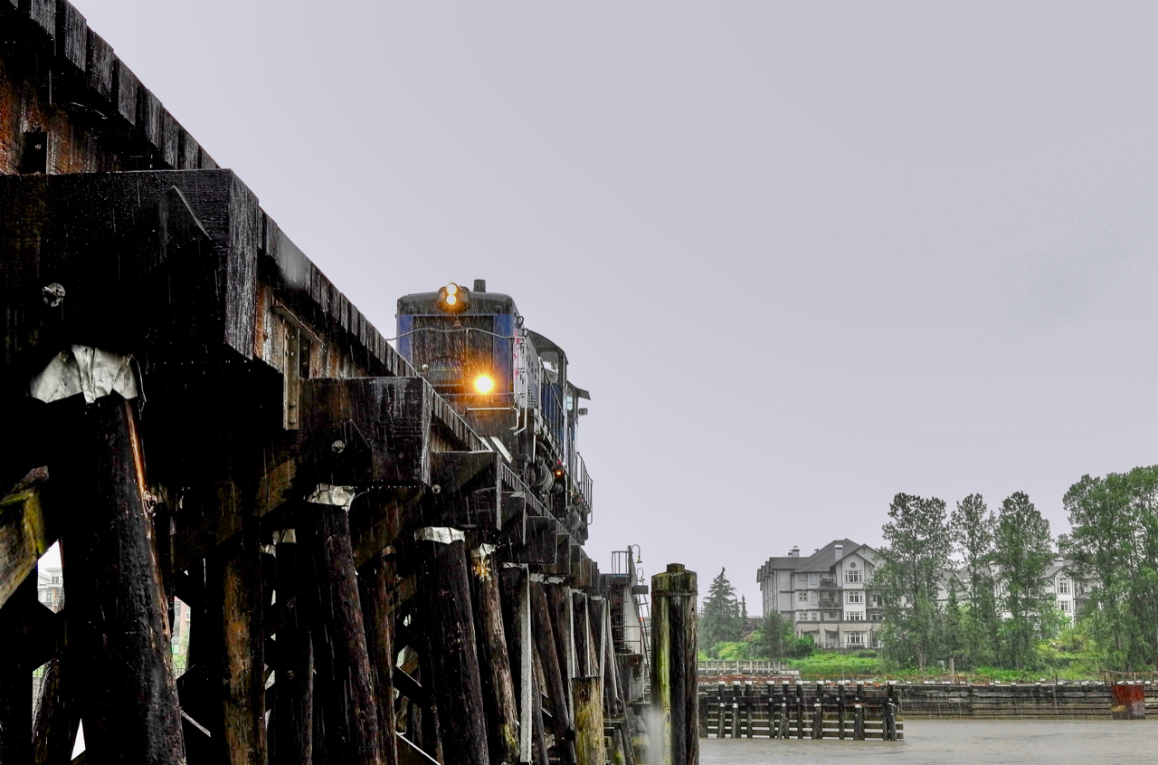 Southern Railway of B.C. (SRY) locomotives cross Fraser River on Queensborough wooden trestle bridge