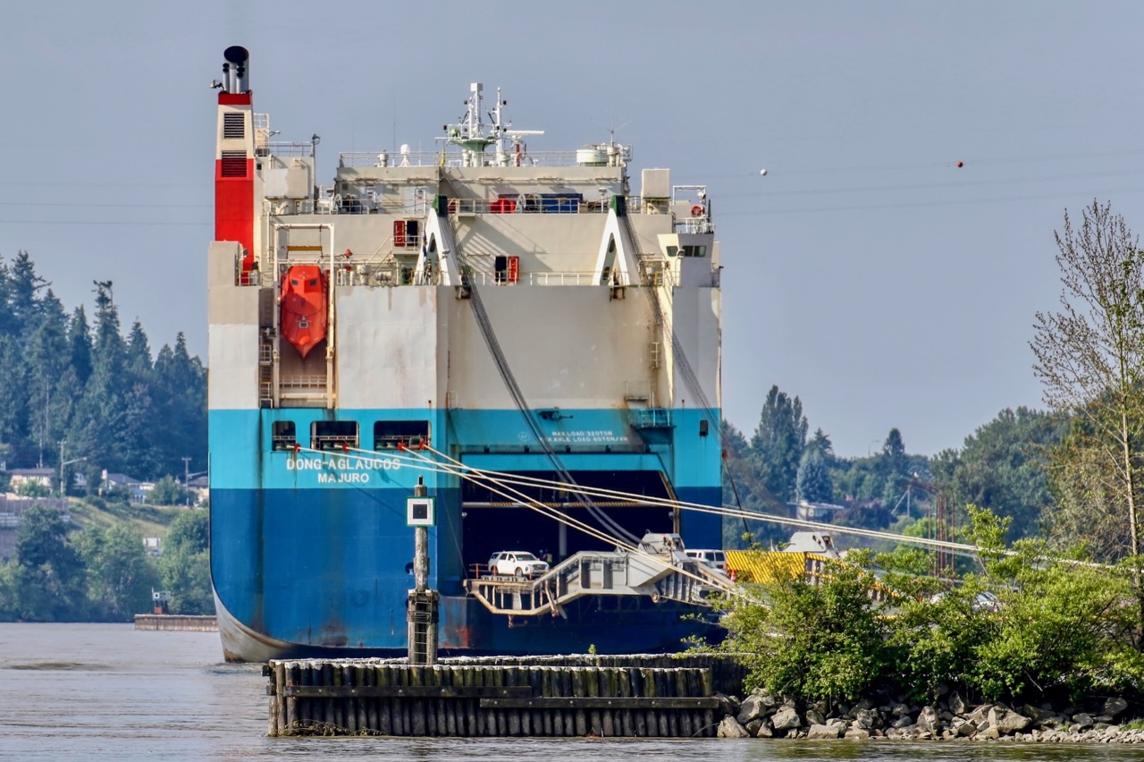 "Vehicles carrier ""DONG-A GLAUCOS"" unloads imports at Annacis Auto Terminal in Fraser River"