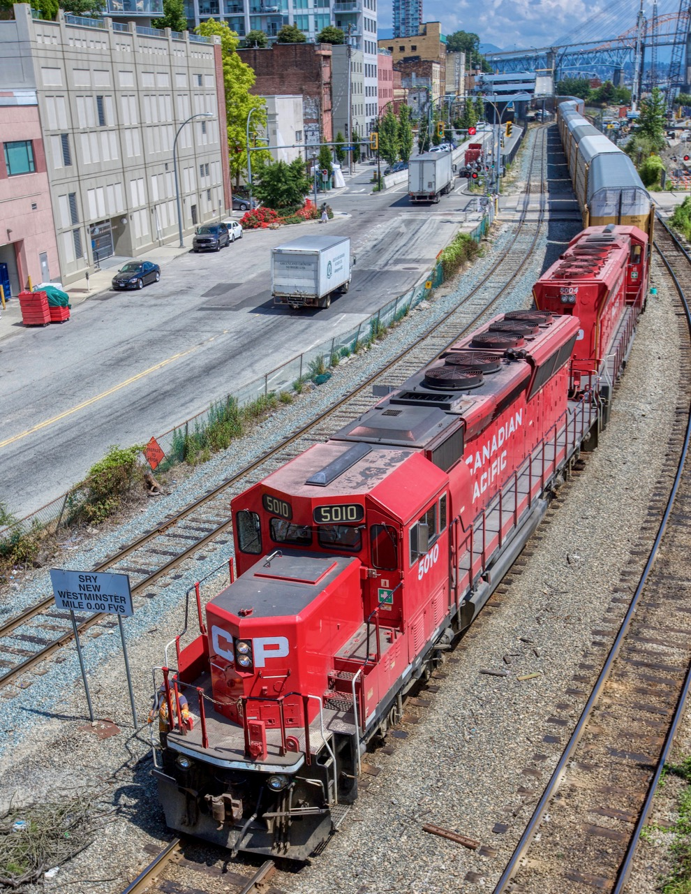 Canadian Pacific Railway (CP) locomotive 5010 leads train, New Westminster B.C.