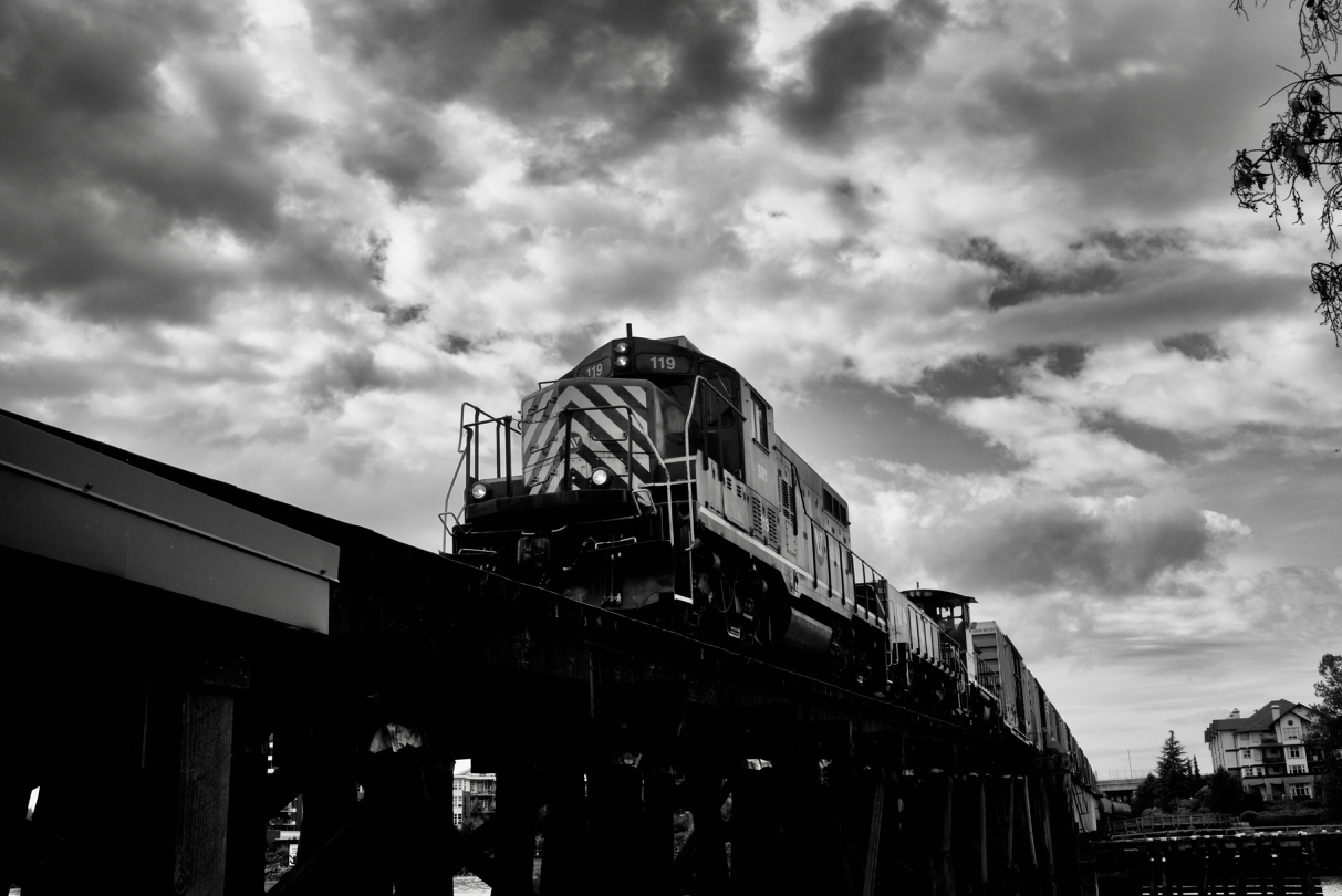 Southern Railway of B.C. (SRY) locomotive 119 leads train on Queensborough Railway Bridge