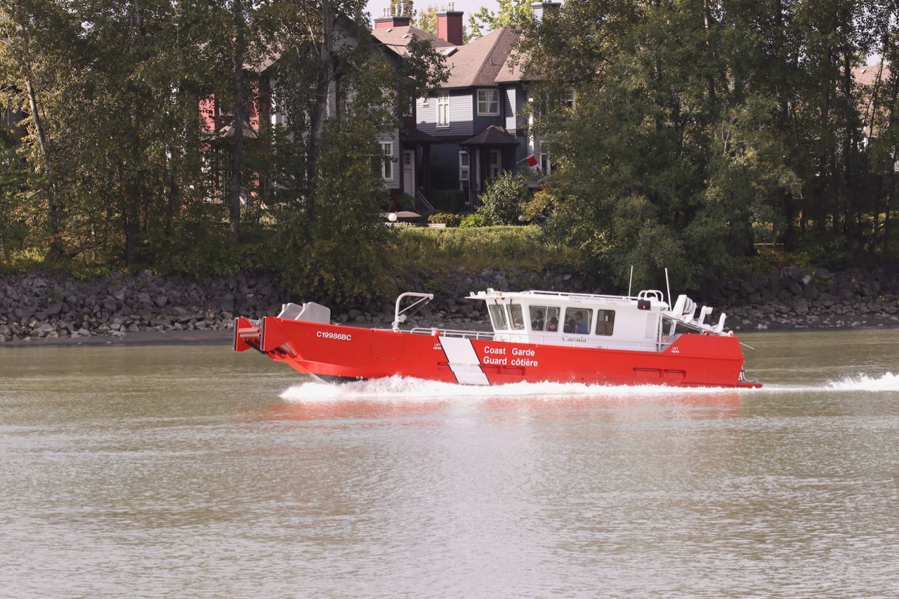 Fisheries and Oceans Canada pollution protection workboat in Fraser River