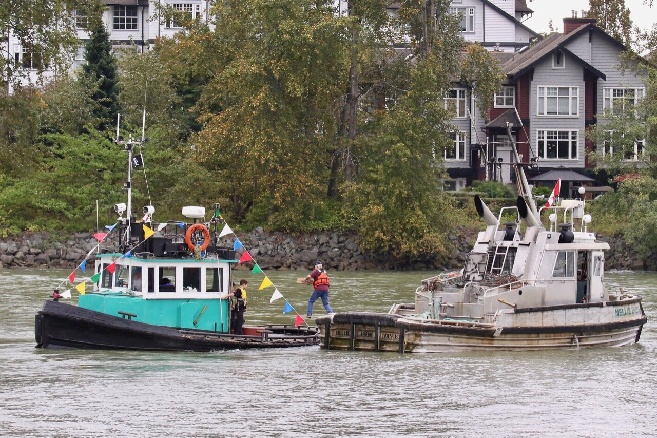 "Transition from ""NELLIE IRENE"" to ""RIVER QUEEN"" during RiverFest 2019 Lucille Johnstone Workboat Parade"