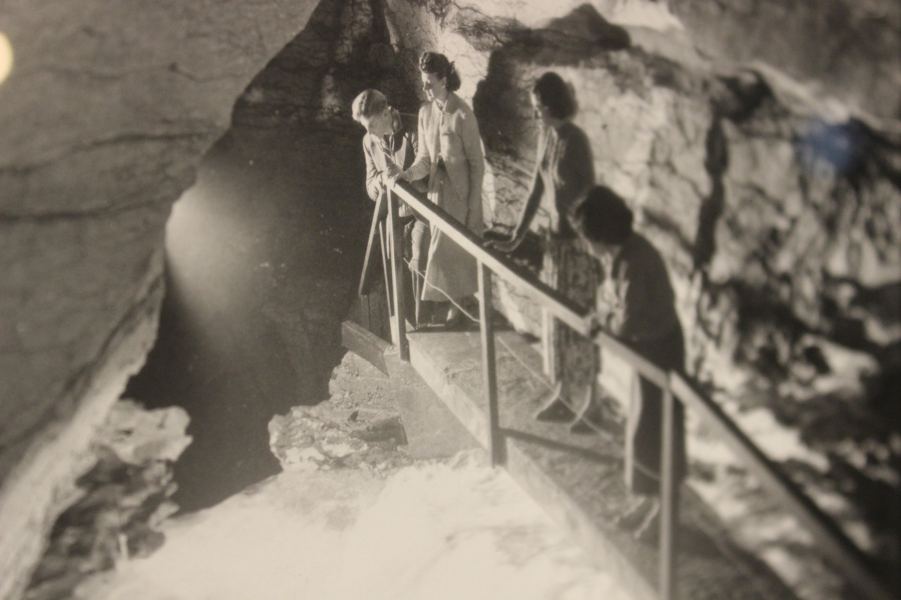 Photo c. 1950, tourists in cave