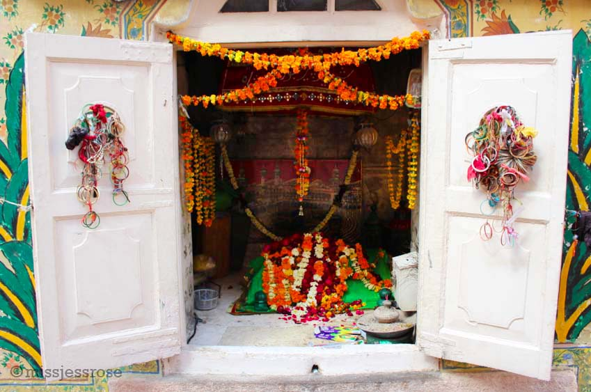 Small temple adorned with offerings