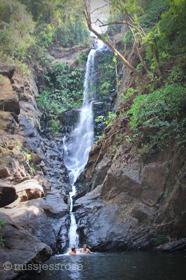 Taking a swim beneath the waterfall