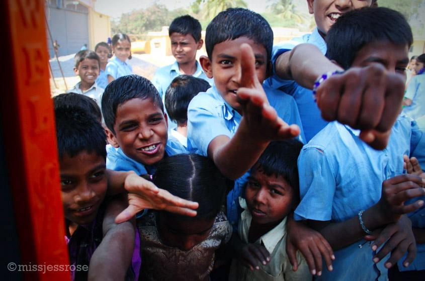 A mob of school children swarm my rickshaw