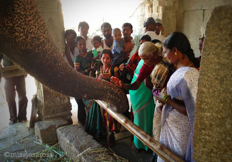 Visitors paying homage to Ganesha aka Lakshmi