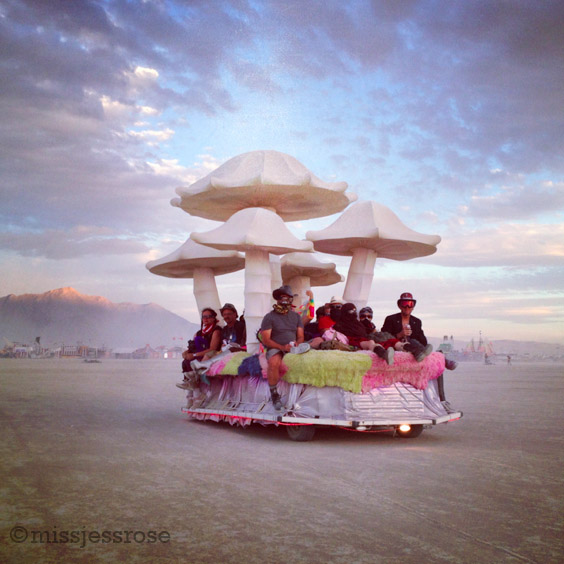 Mushroom art car driving out to wait for the Man burn at sunset