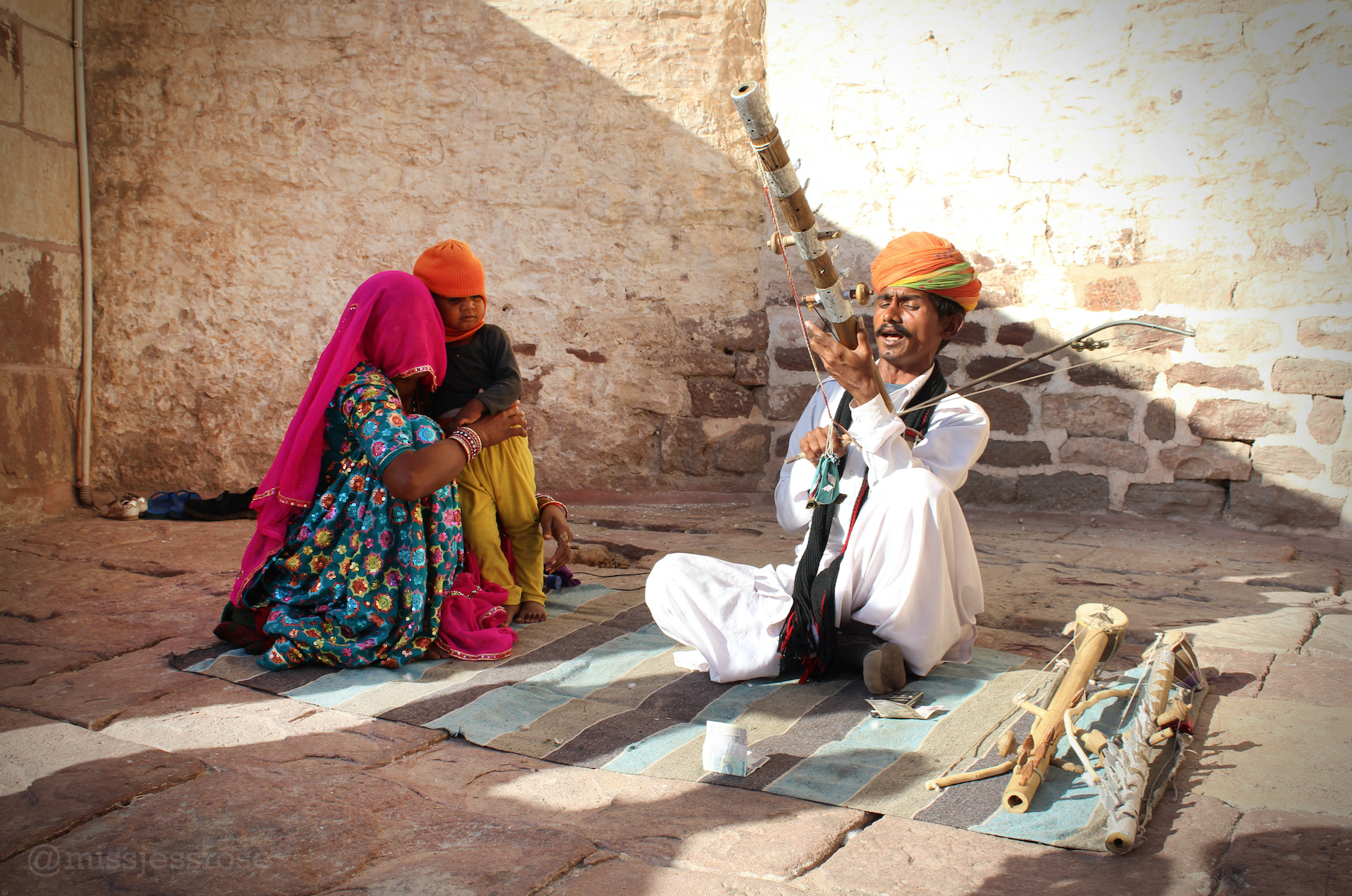 Musicians playing traditional instruments sit throughout the grounds.
