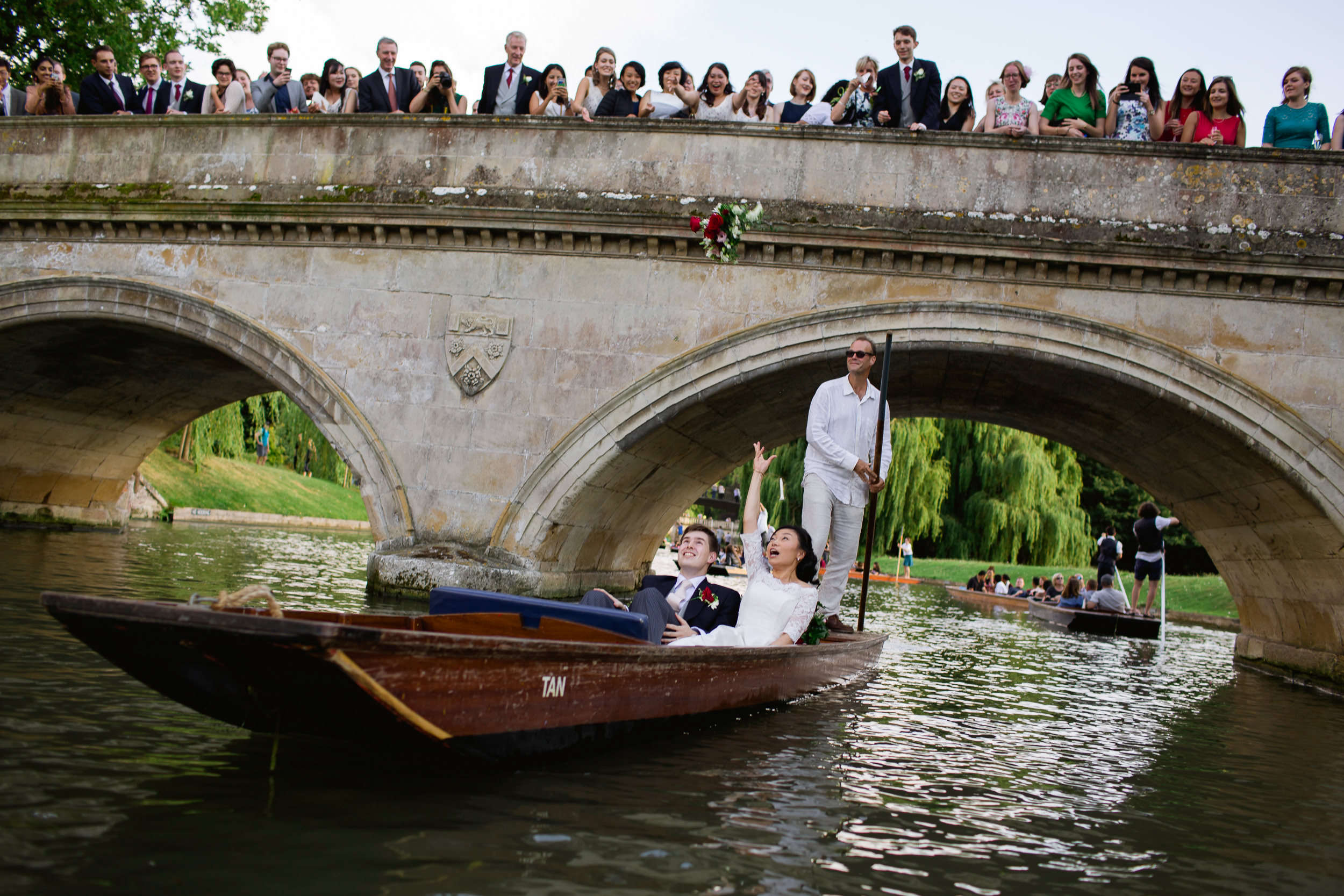 wedding bouquet throw - Cambridge wedding - bride and groom in a punt - Cambridge wedding
