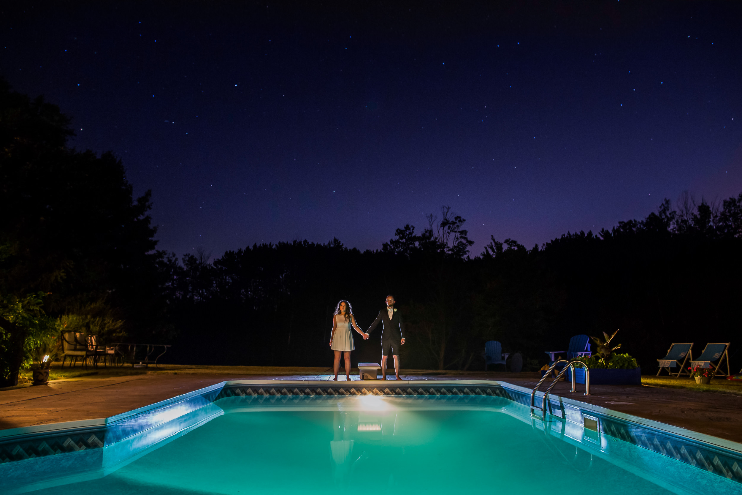 Night time photography - Canadian wedding - swimming pool at a wedding