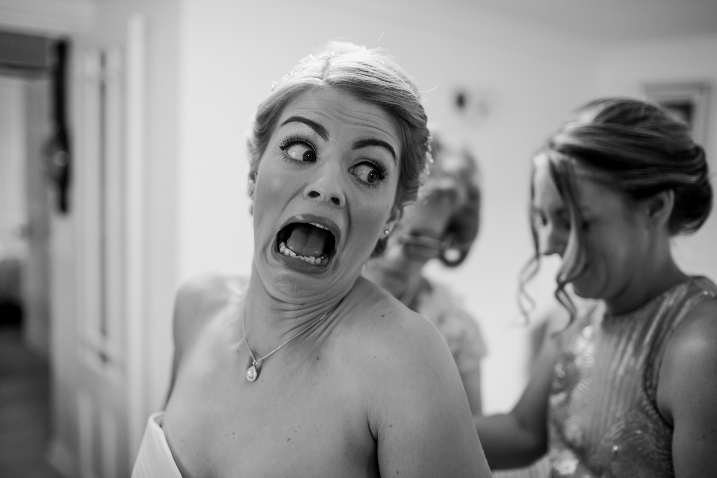 Bride getting dressed - bride pulling a funny face - Yorkshire wedding