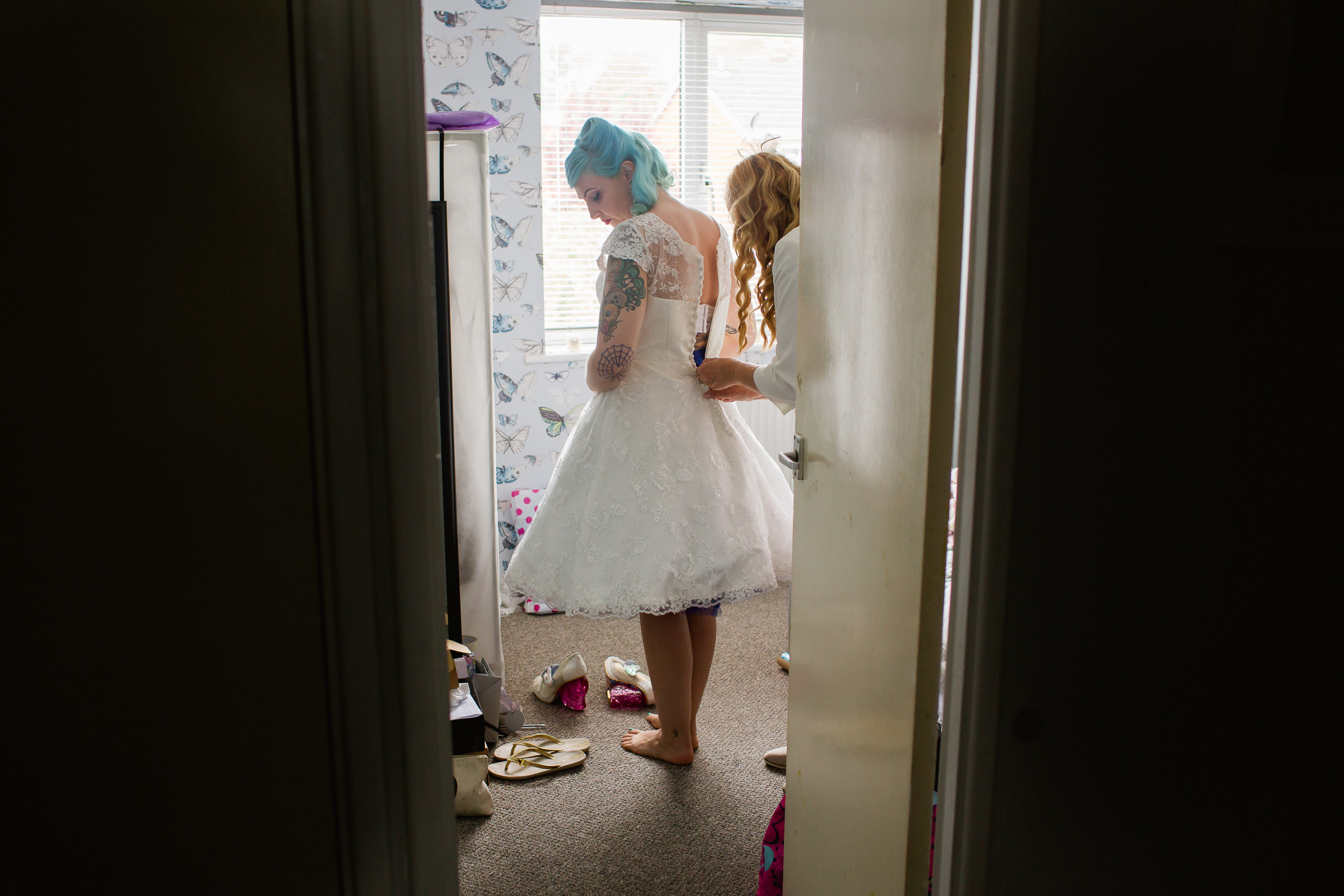 alternative bride - bride getting dressed - blue haired bride - birmimgham wedding