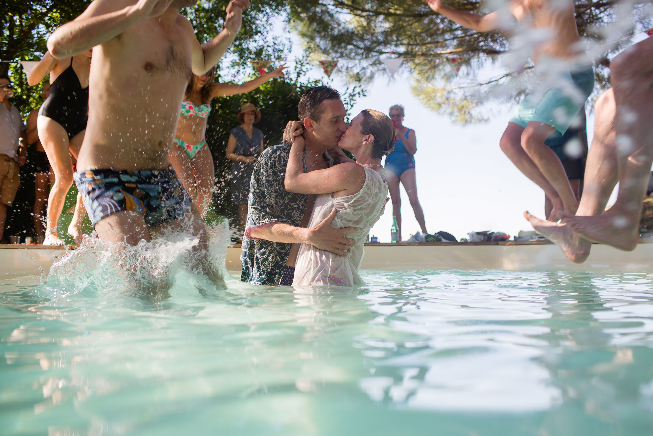 bride and groom in a pool - wedding pool party - wedding at Castelnau Des Fieumarcon