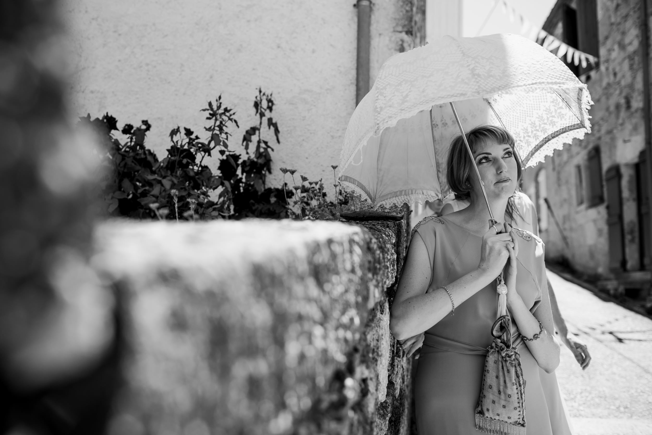 A bridesmaid - Bridesmaid with umbrella - wedding at Castelnau Des Fieumarcon