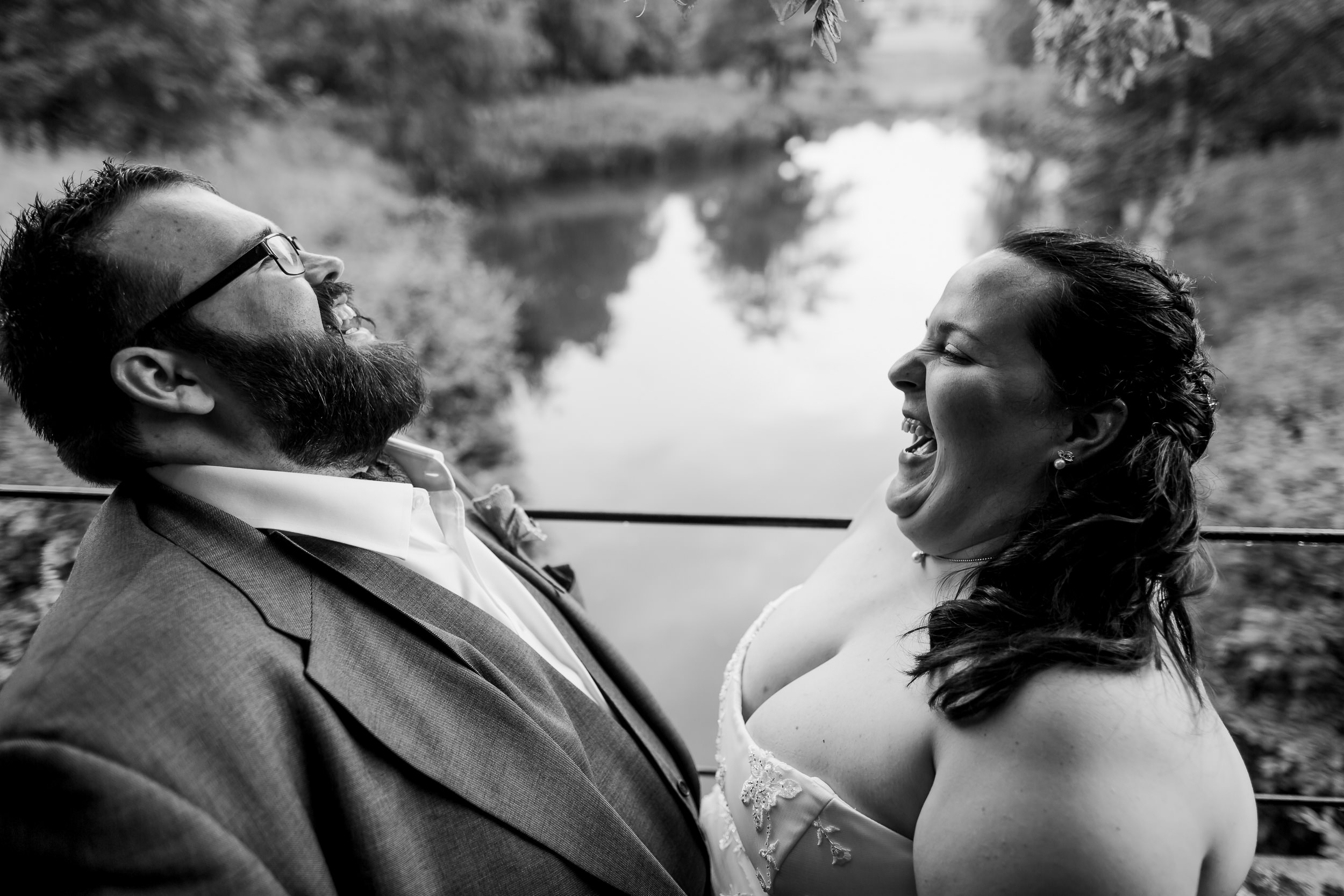 Bride and groom laughing on their wedding day - weddings at YSP - Yorkshire Sculpture Park weddings