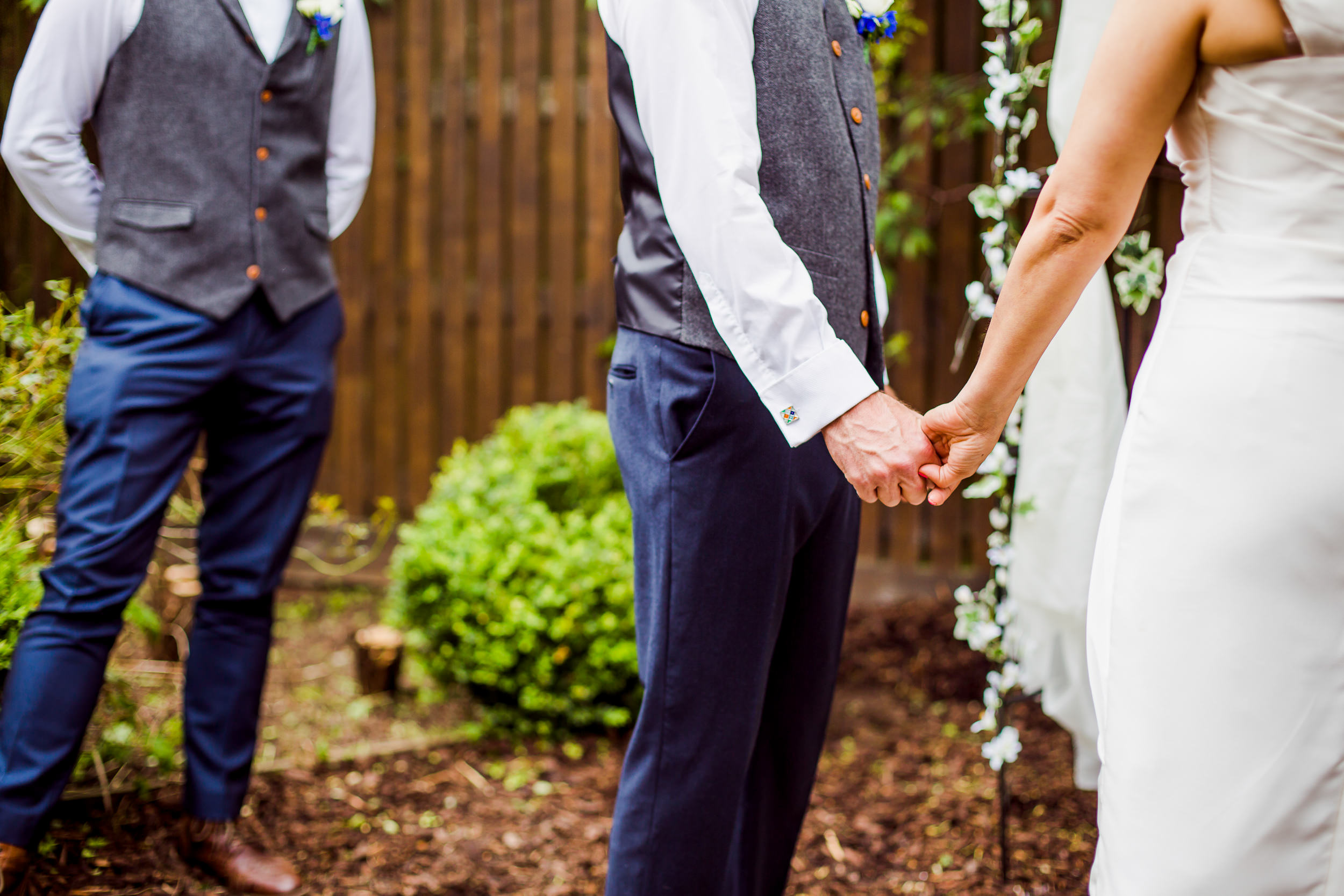 Back garden wedding - holding hands at a wedding - Yorkshire wedding