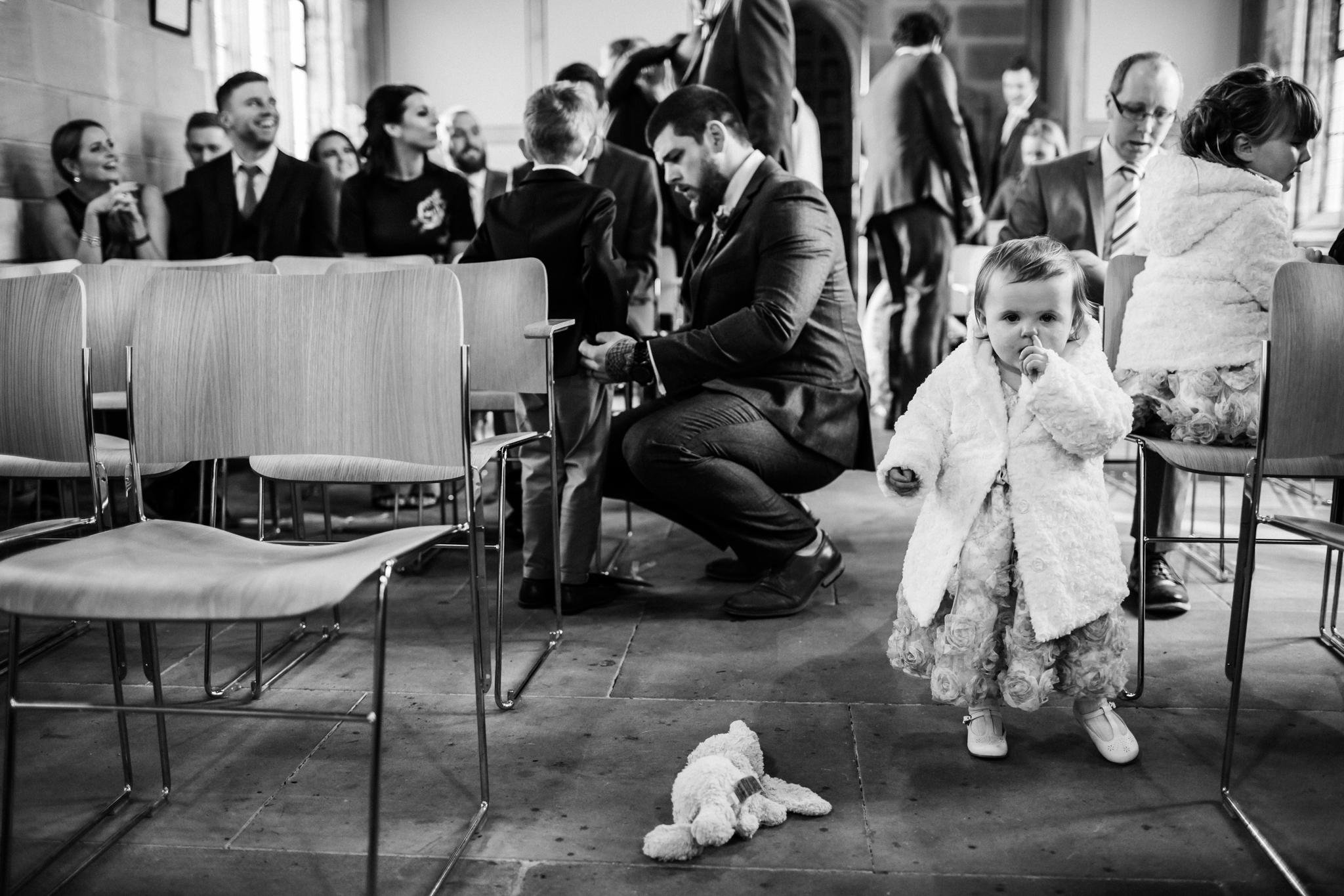 nose picking baby at a wedding