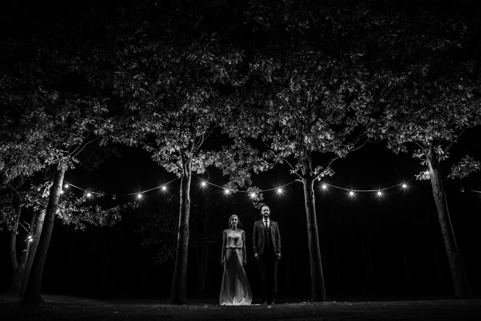 portraits under festoon lights at shustoke barn