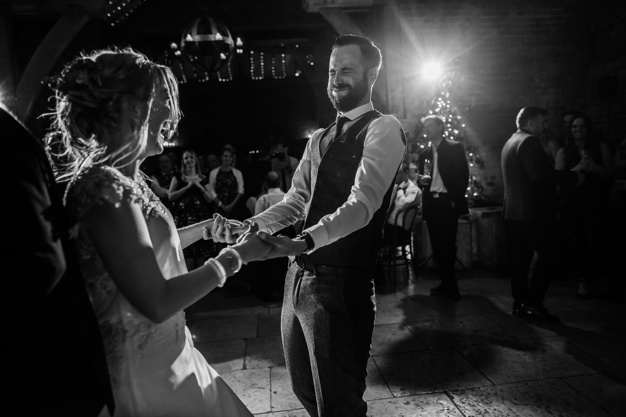 bride and groom dancing at shustoke barn