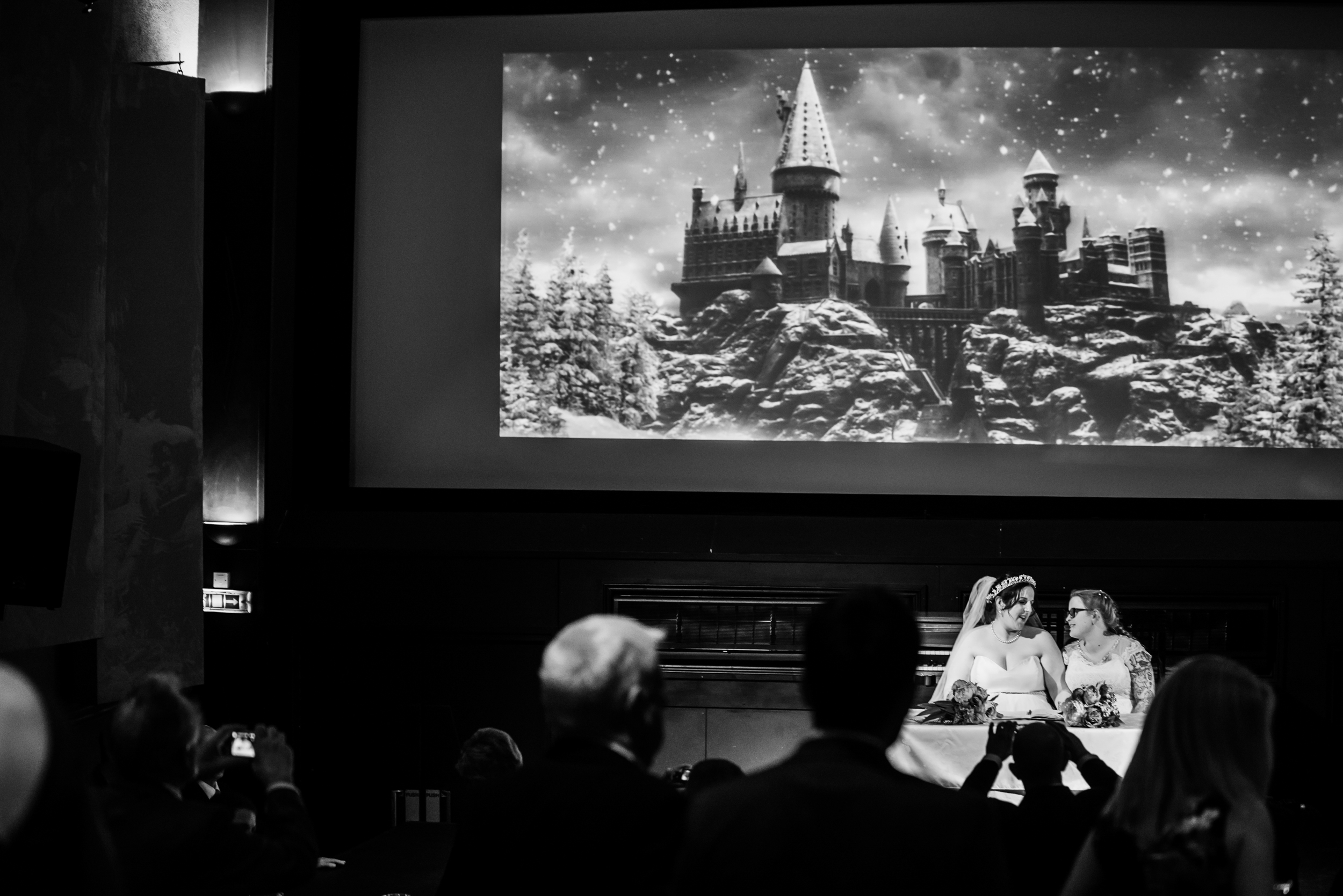 Signing of the register with Hogwarts in the background