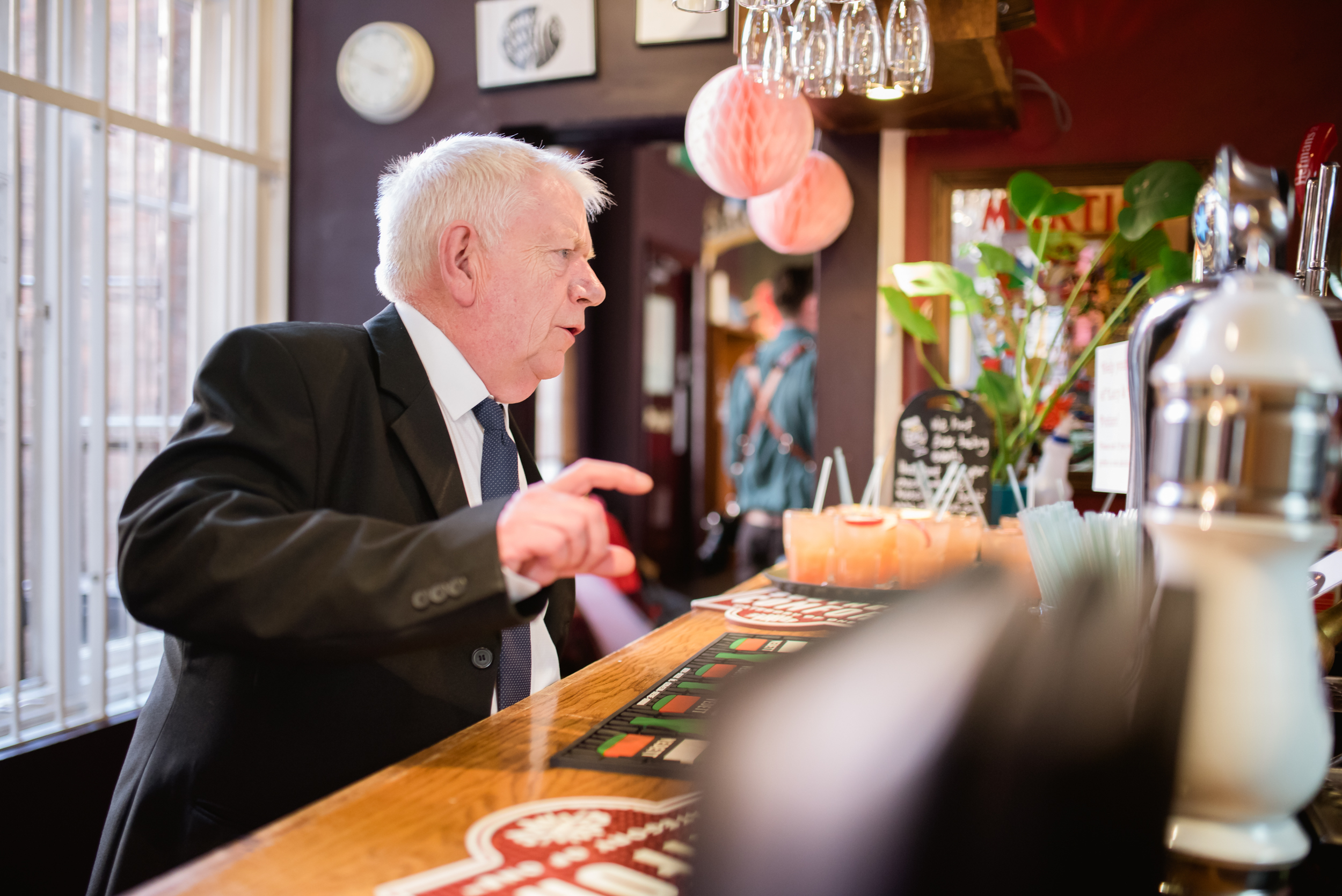 wedding guest ordering a drink at Cherry Reds