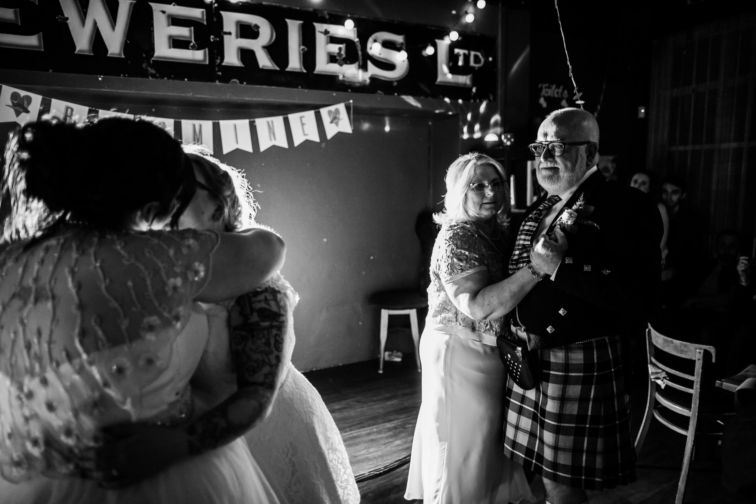 Parents watch a first dance