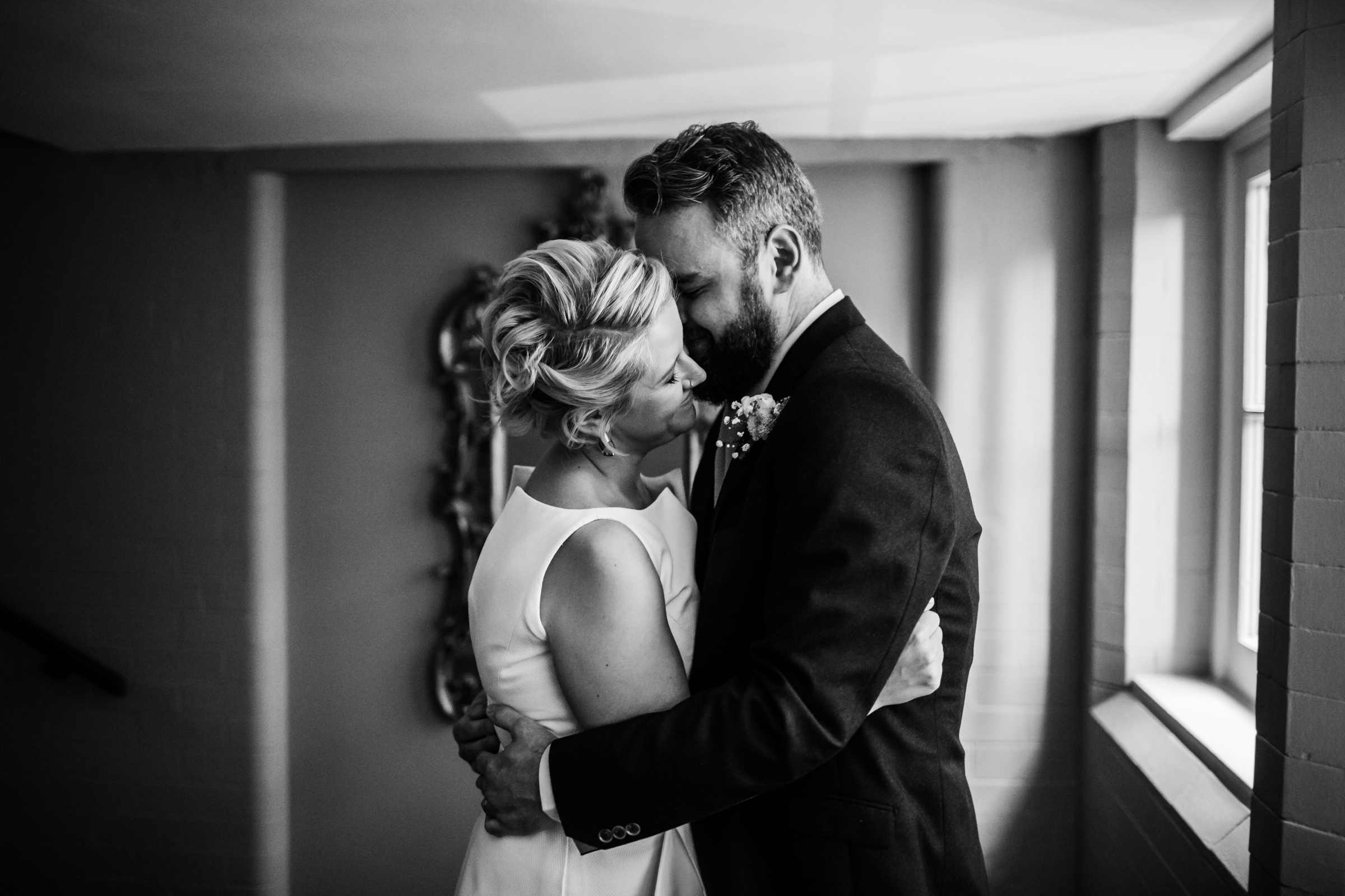 a bride and groom cuddle at great john street hotel manchester