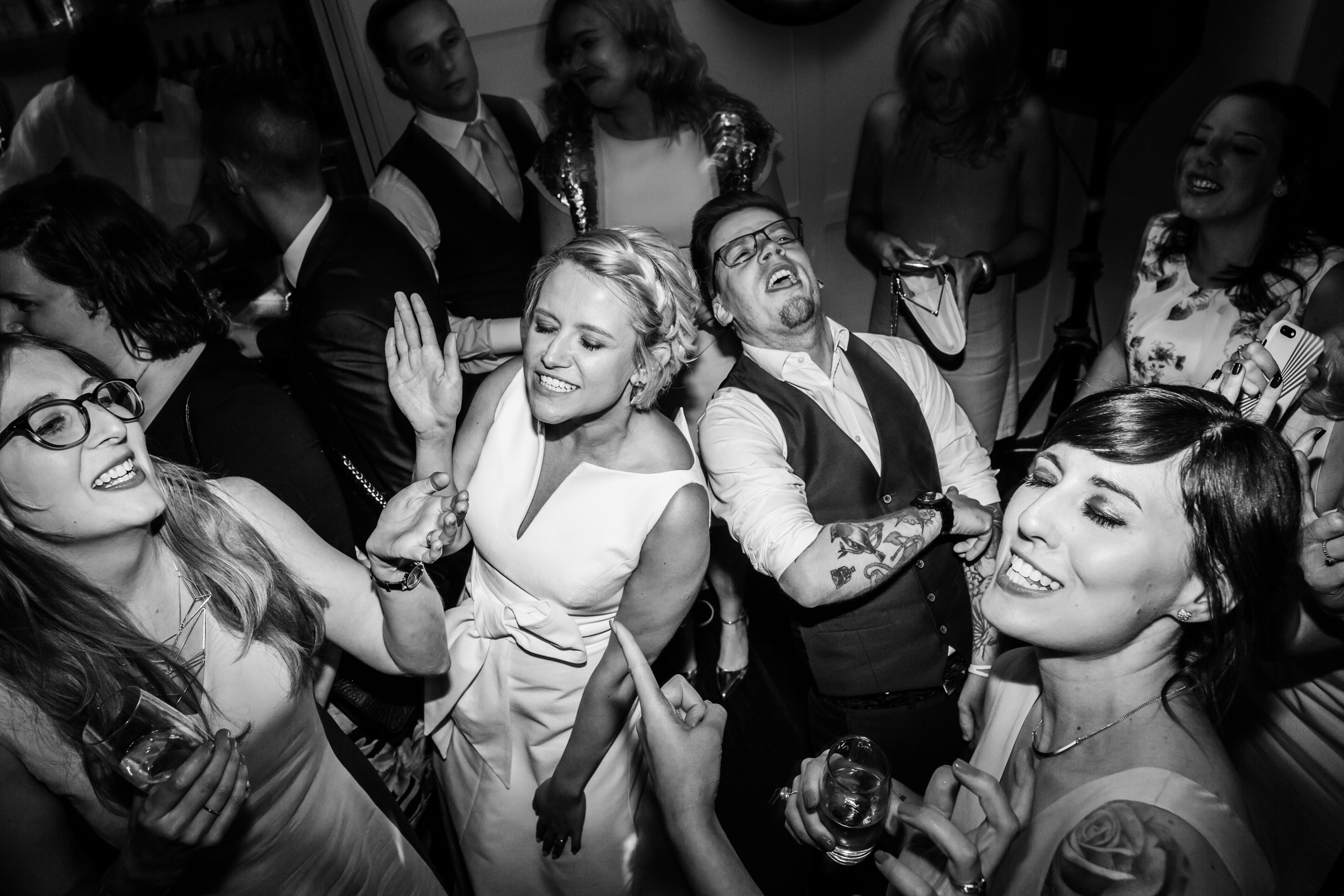 a packed dance floor during a wedding at great john street hotel manchester