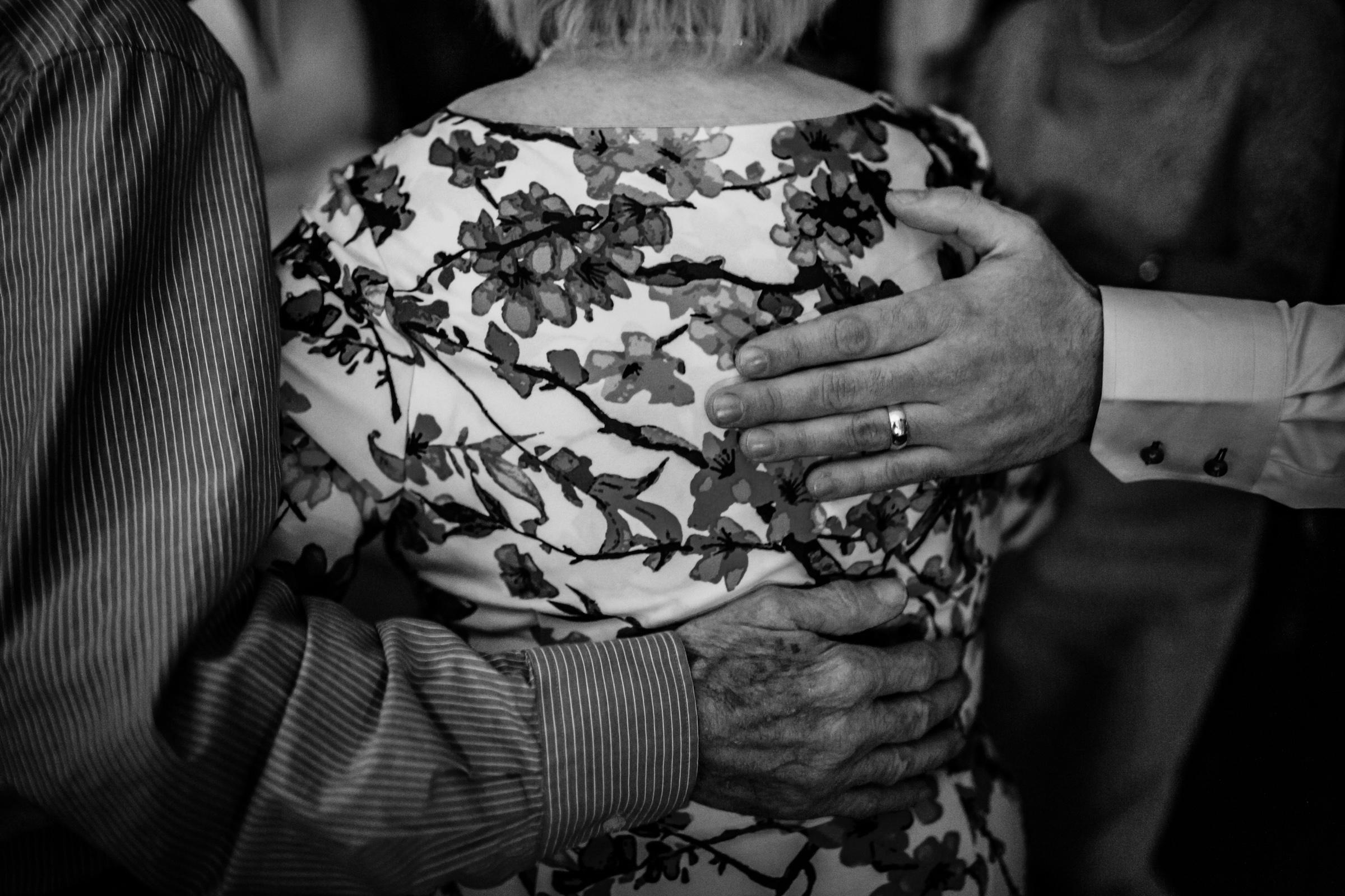 hugs at a wedding atgreat john street hotel manchester