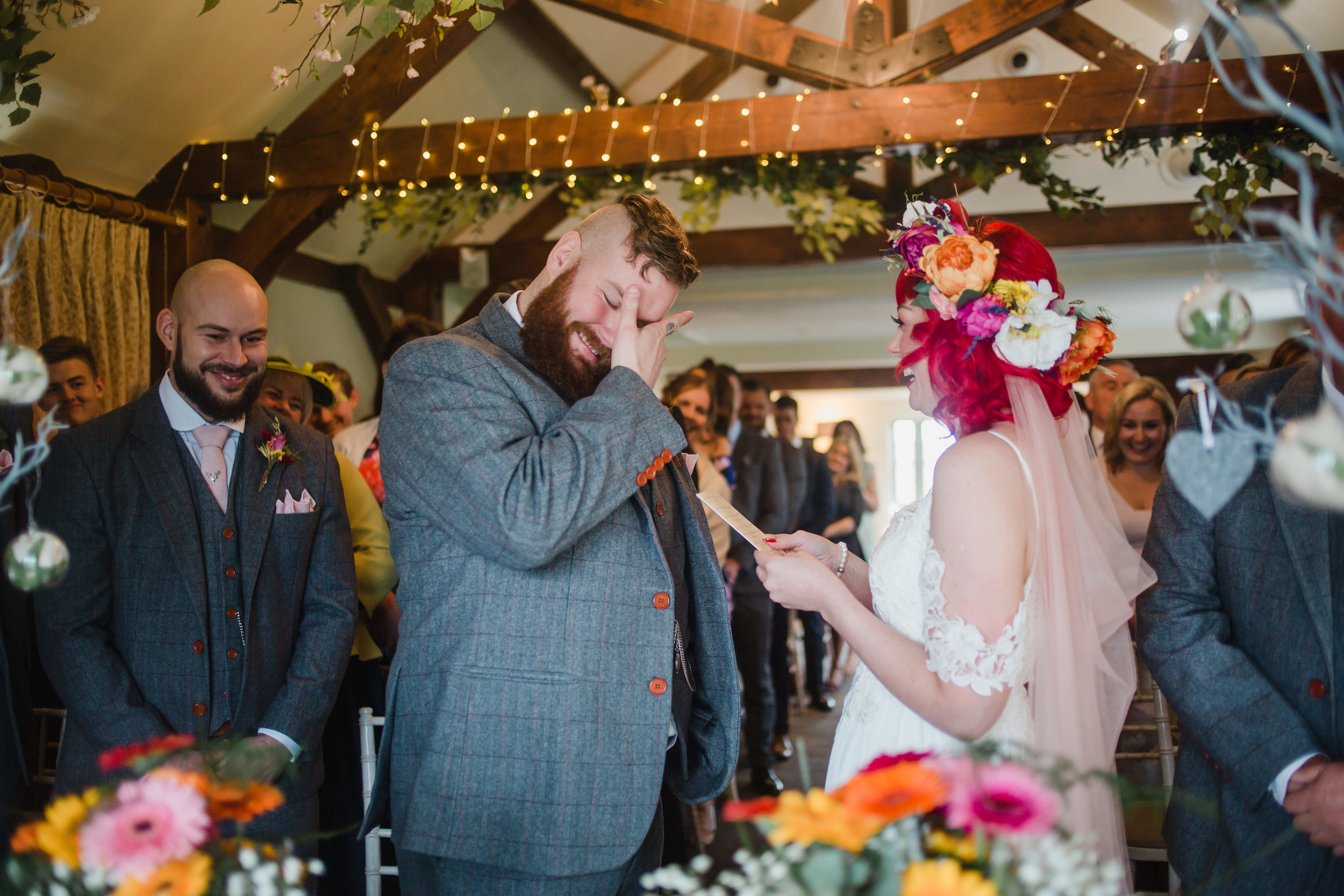A groom cries during a wedding ceremony at the compasses at pattiswick