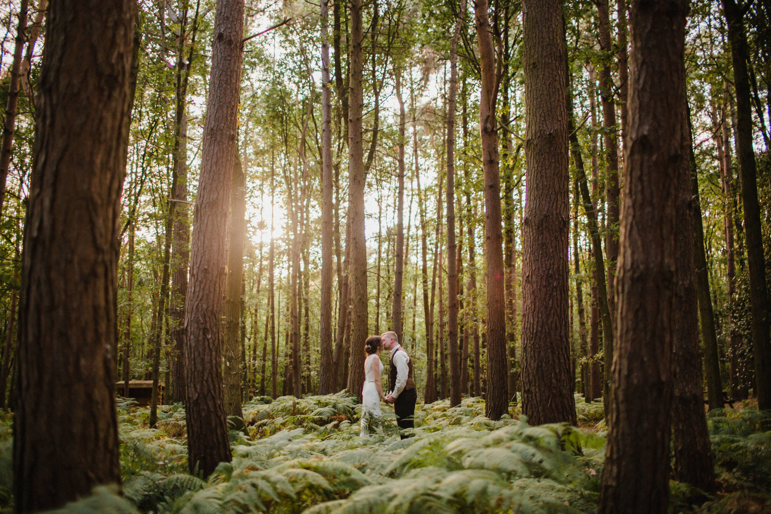 a bride and groom portrait shot in the forest at enchanted woodland weddings birmigham