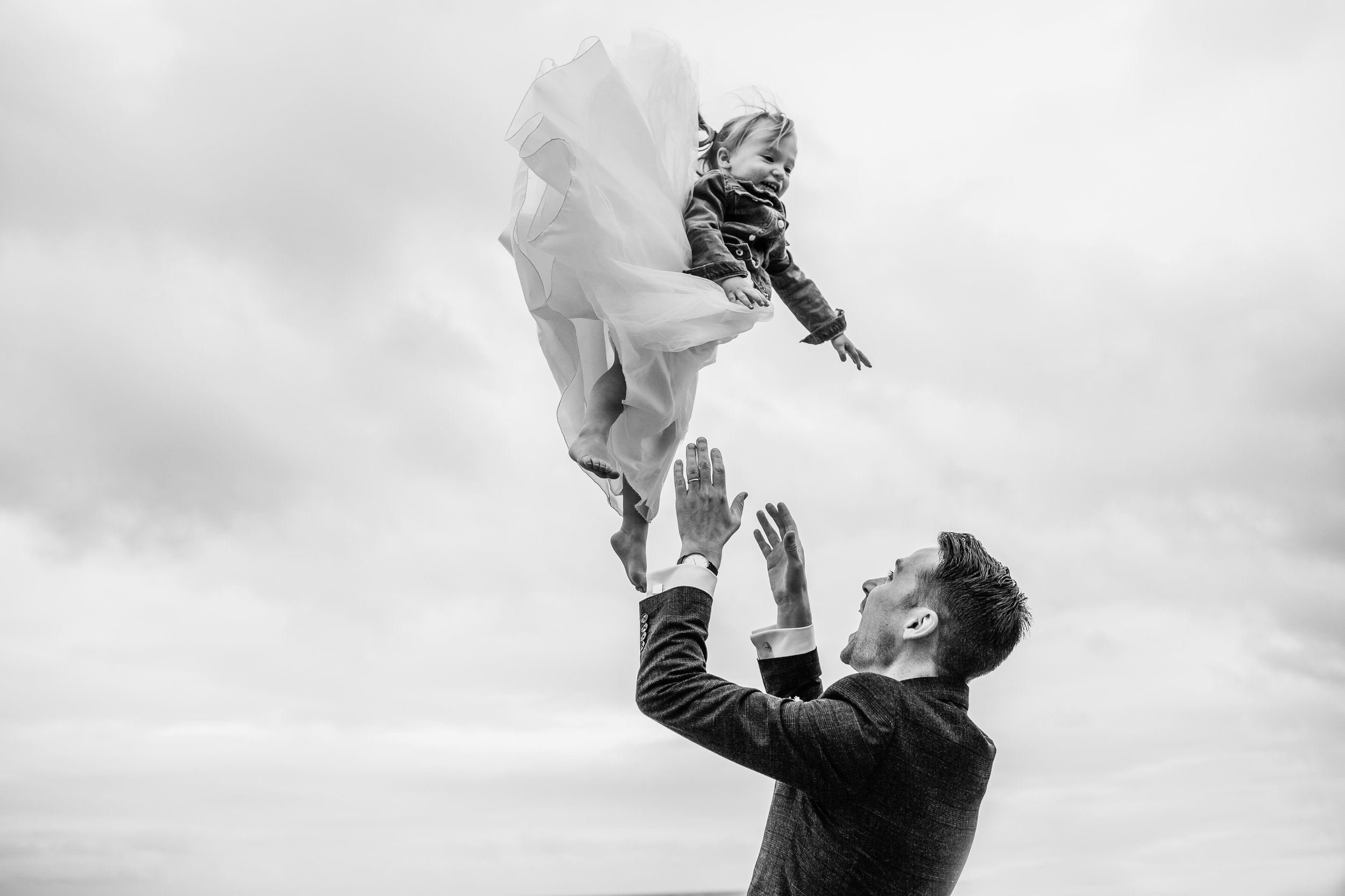 A groom throws his daughter in the air at rosevine hotel truro cornwall