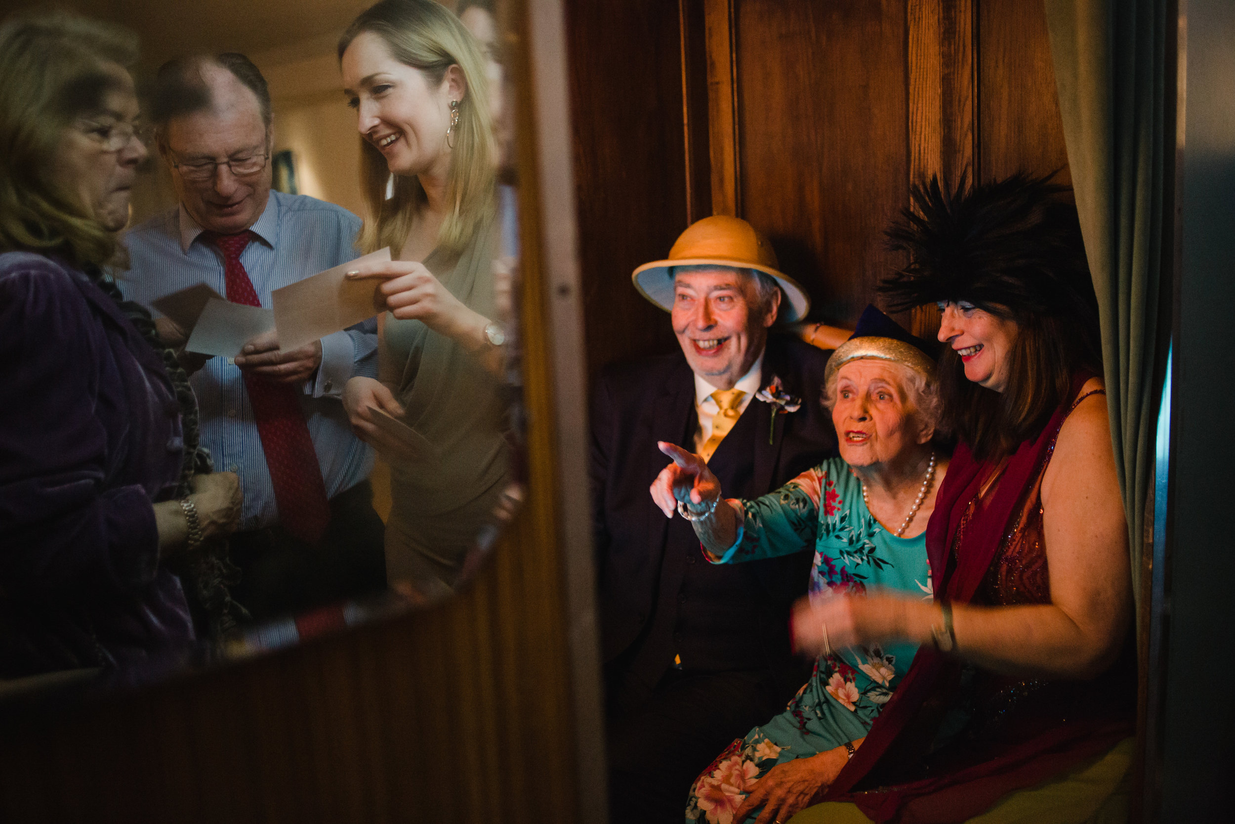 older wedding guests have a photo in a photobooth at a wedding bristol