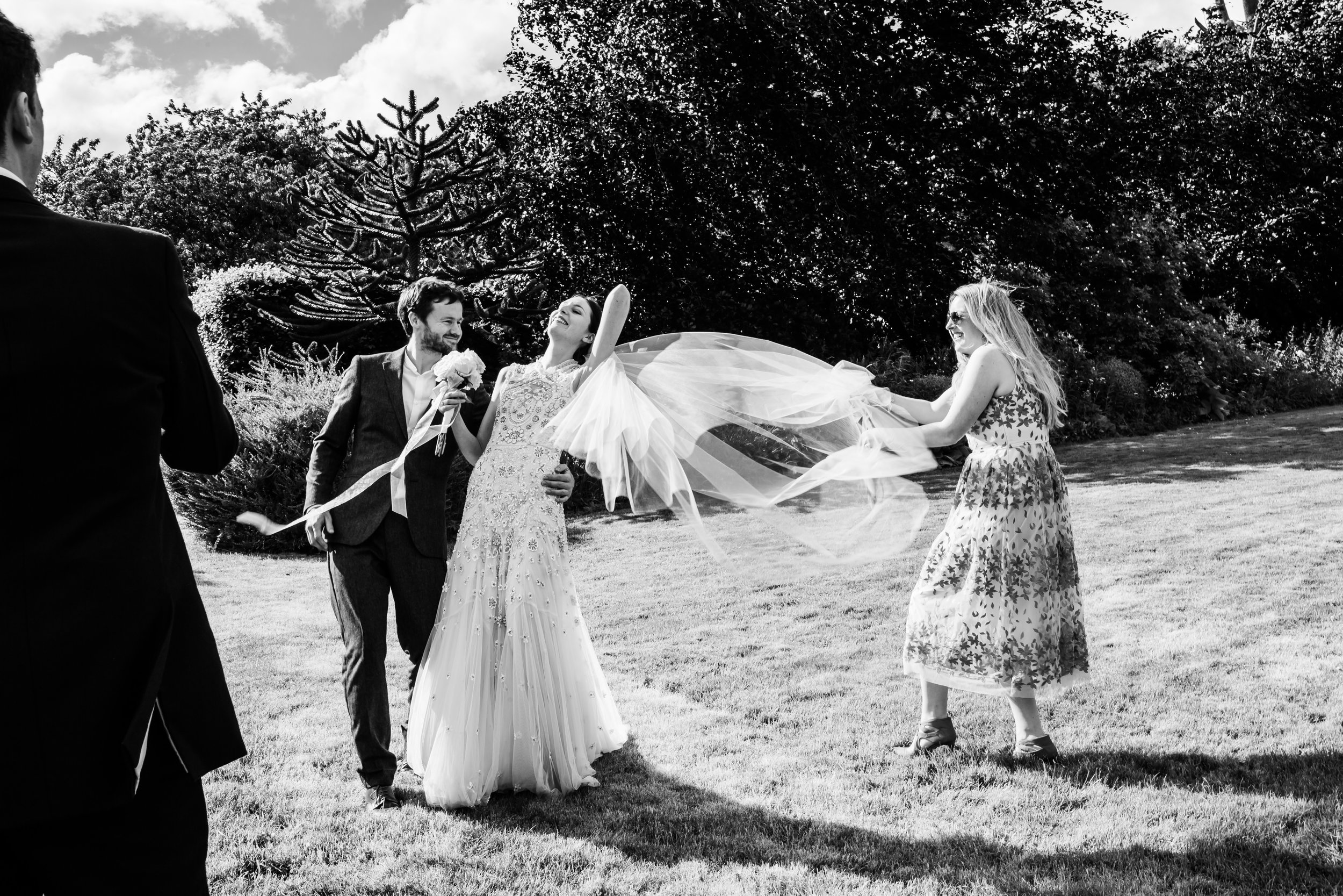 A brides veil blows in the wind