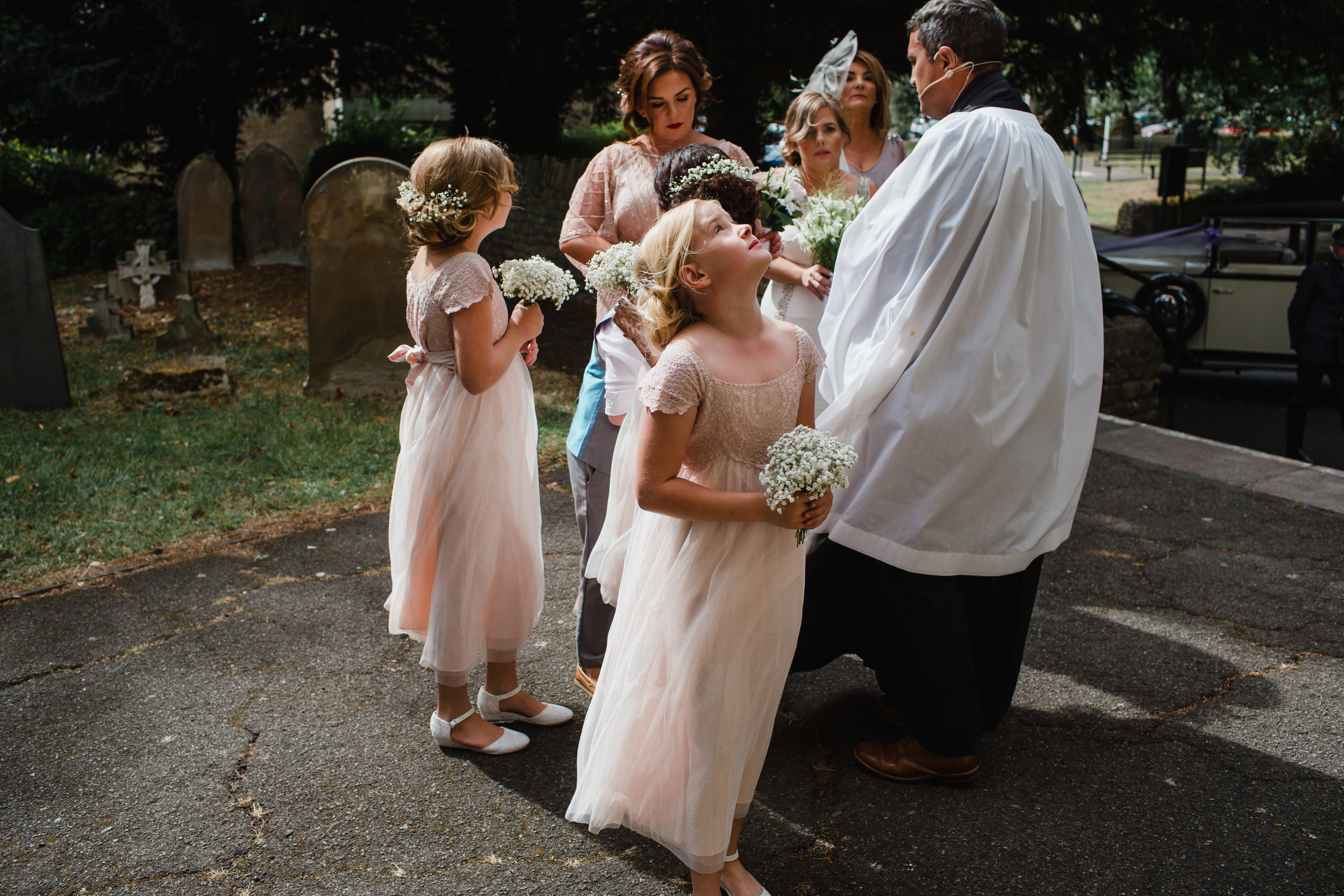 flower girls and the priest in corby
