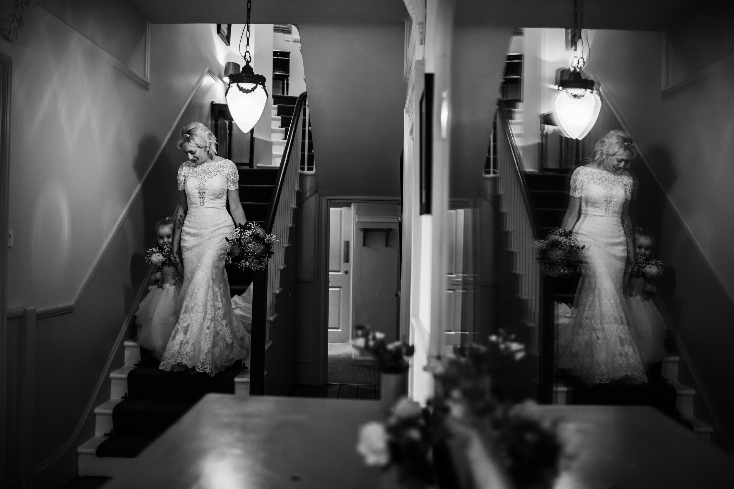 a bride and her daughter walk to a wedding ceremony at rosevine hotel cornwall