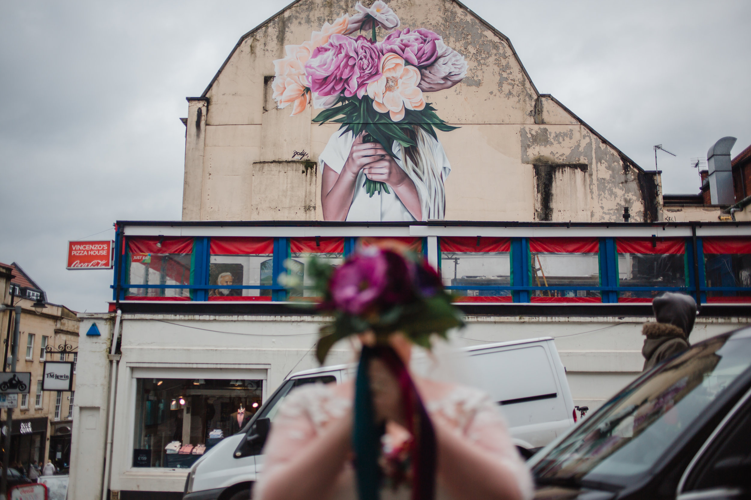 two brides and flowers - street art in bristol