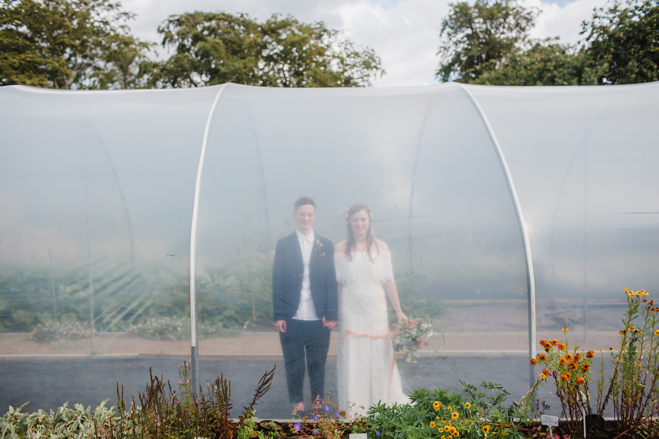 bride and groom in a poly tunnel at stanton hall and gardens