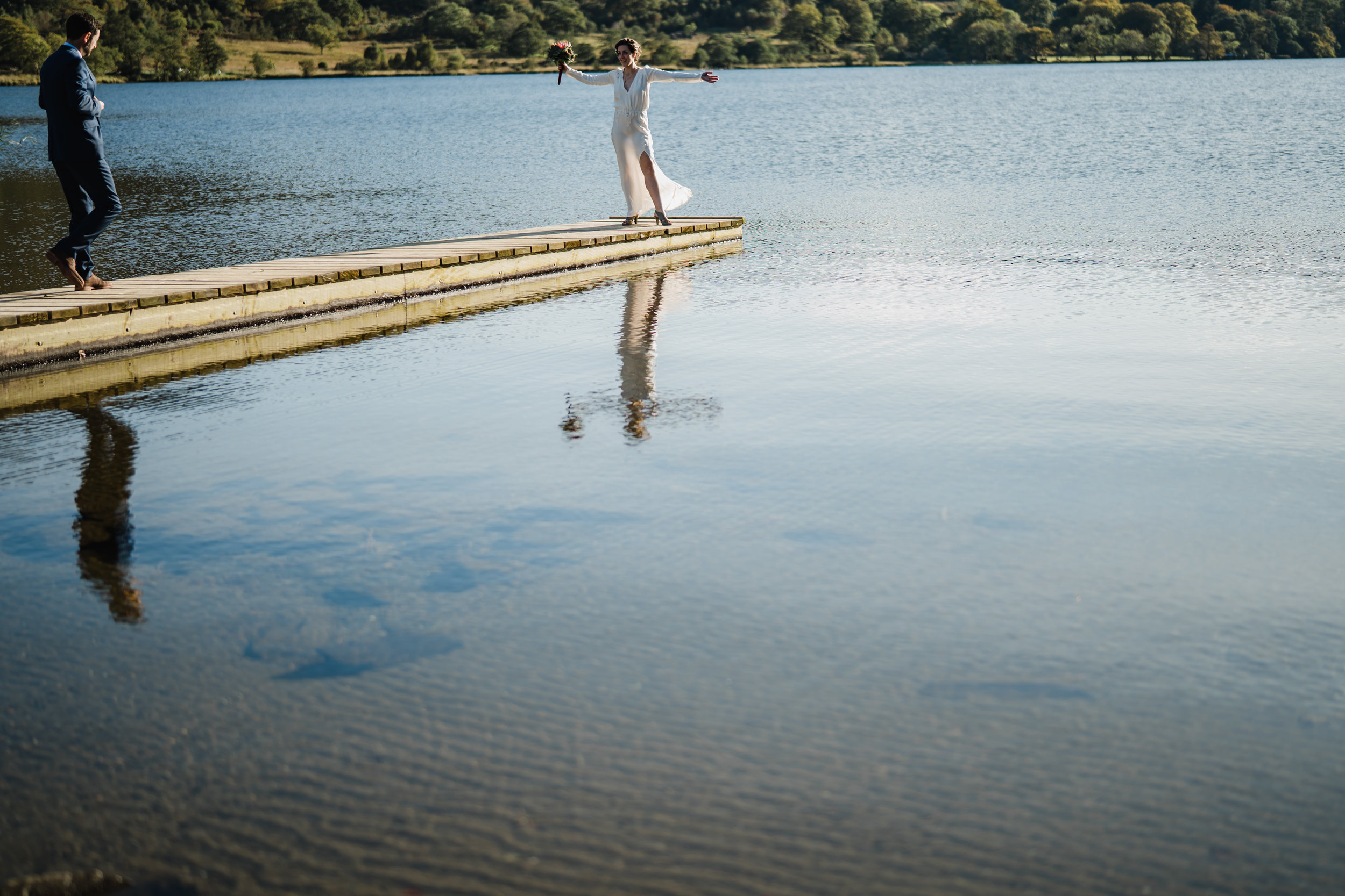 a bride an groom in a lake in snowdonia