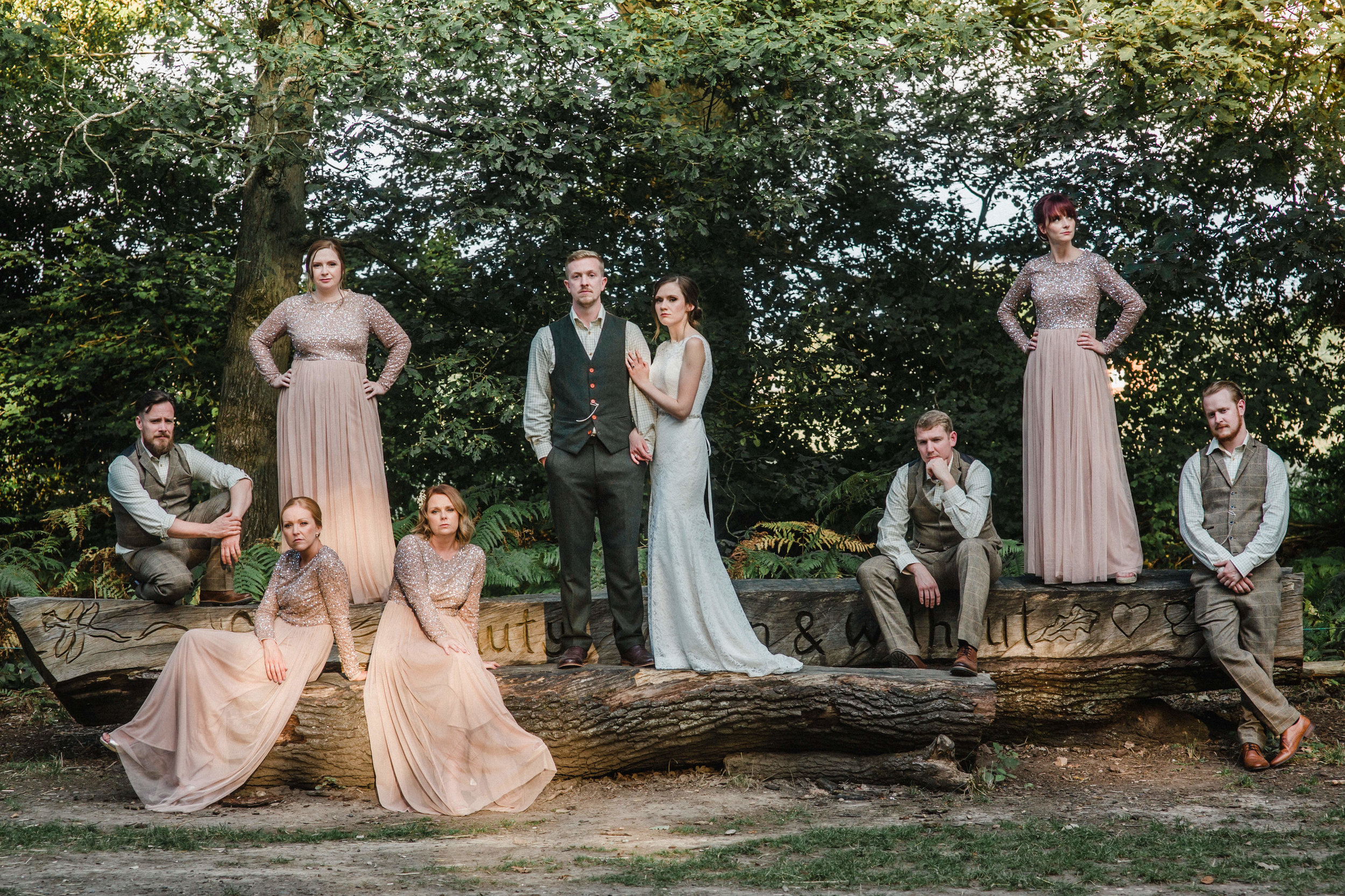 a creative group shot reminiscent of vogue at enchanted weddings Birmingham