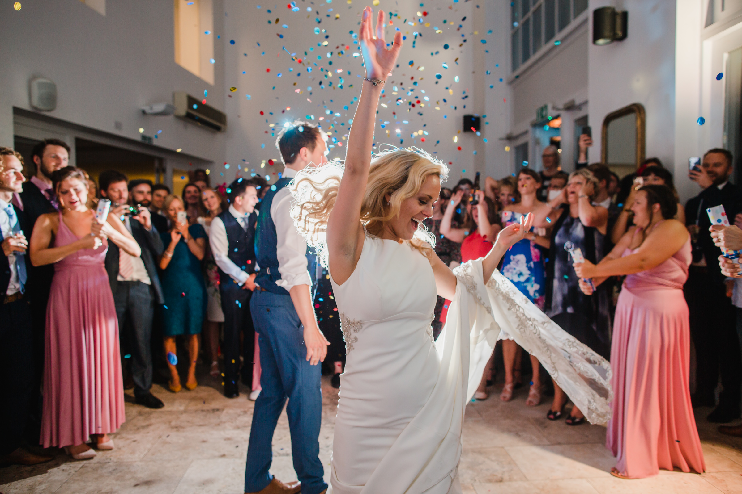a bride twirls during her forst dance as a confettis canon explodes at fazeley studios Birmingham