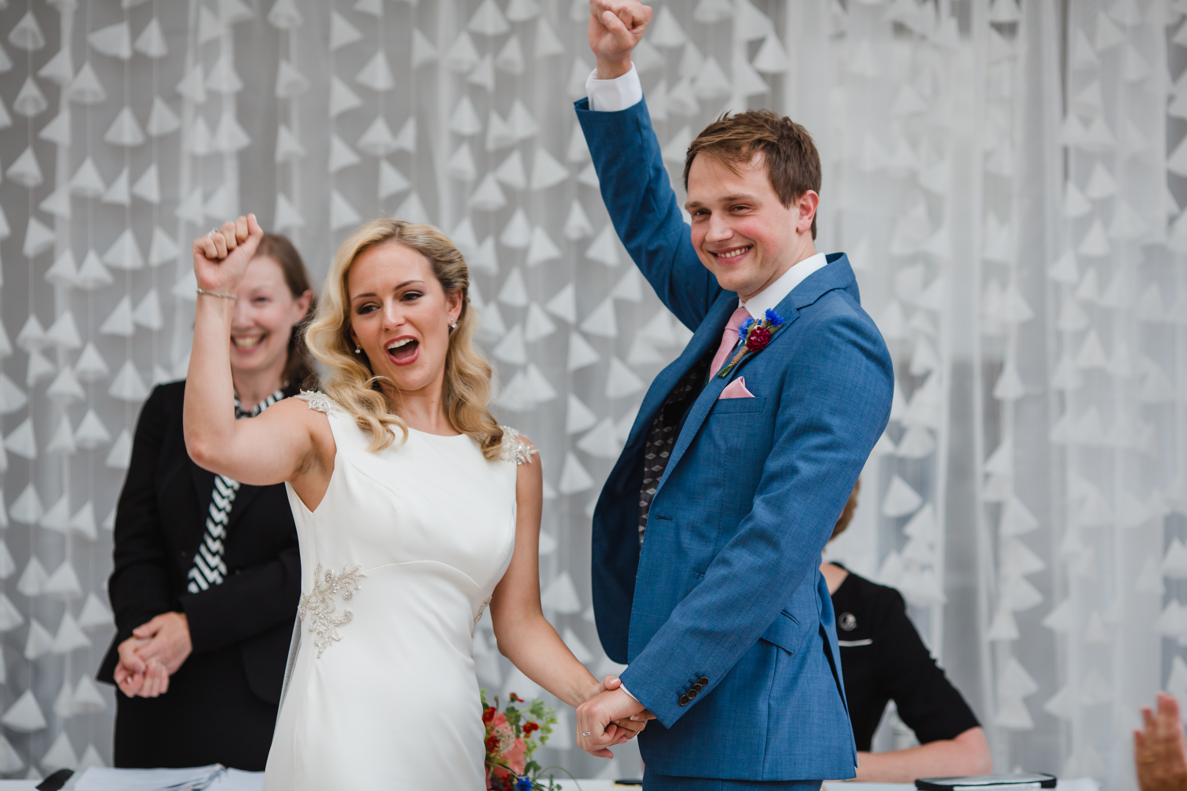 a cheer goes up as a bride and groom are married at fazeley studios birmingham