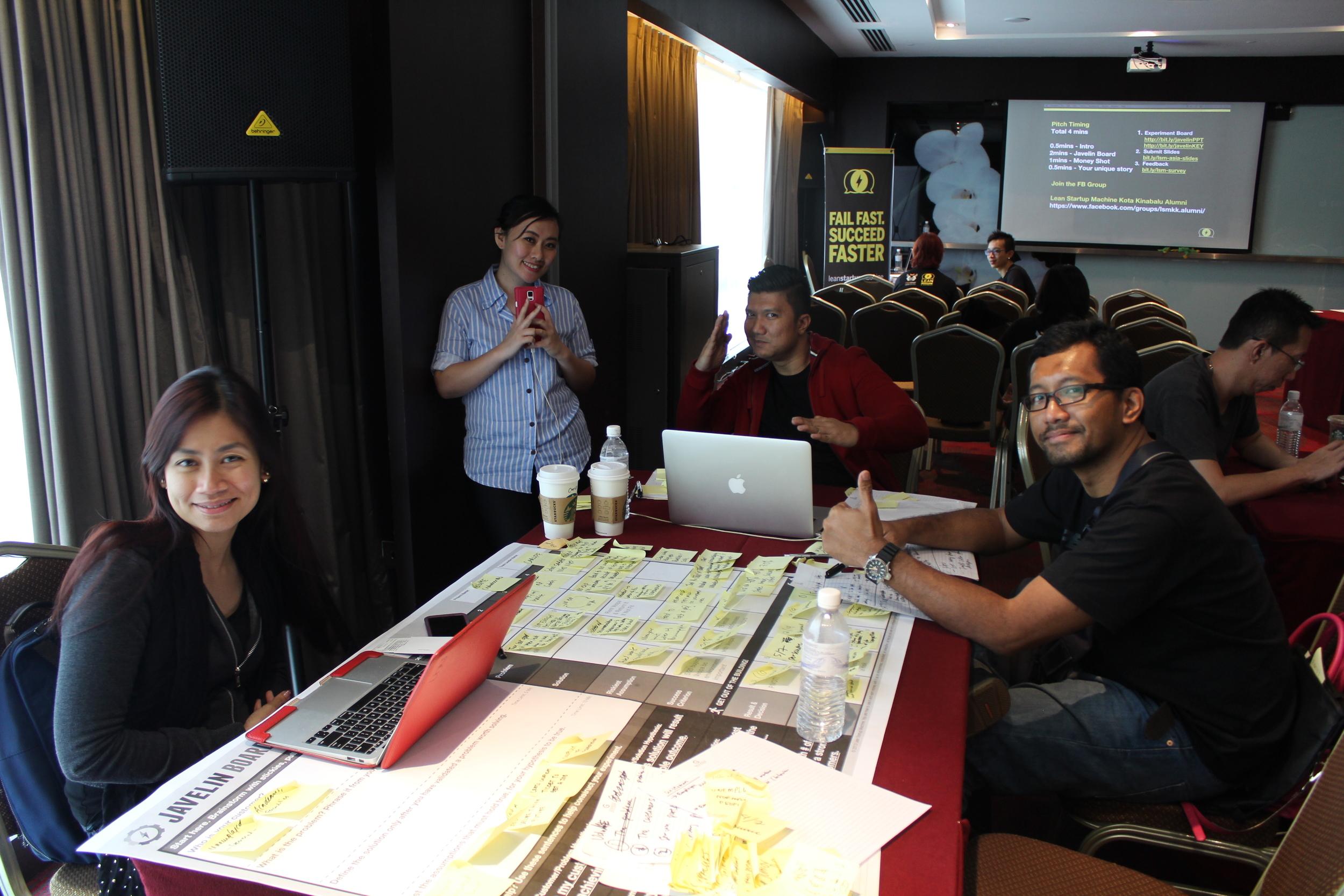 Team VoluME had time to pose while preparing their presentation