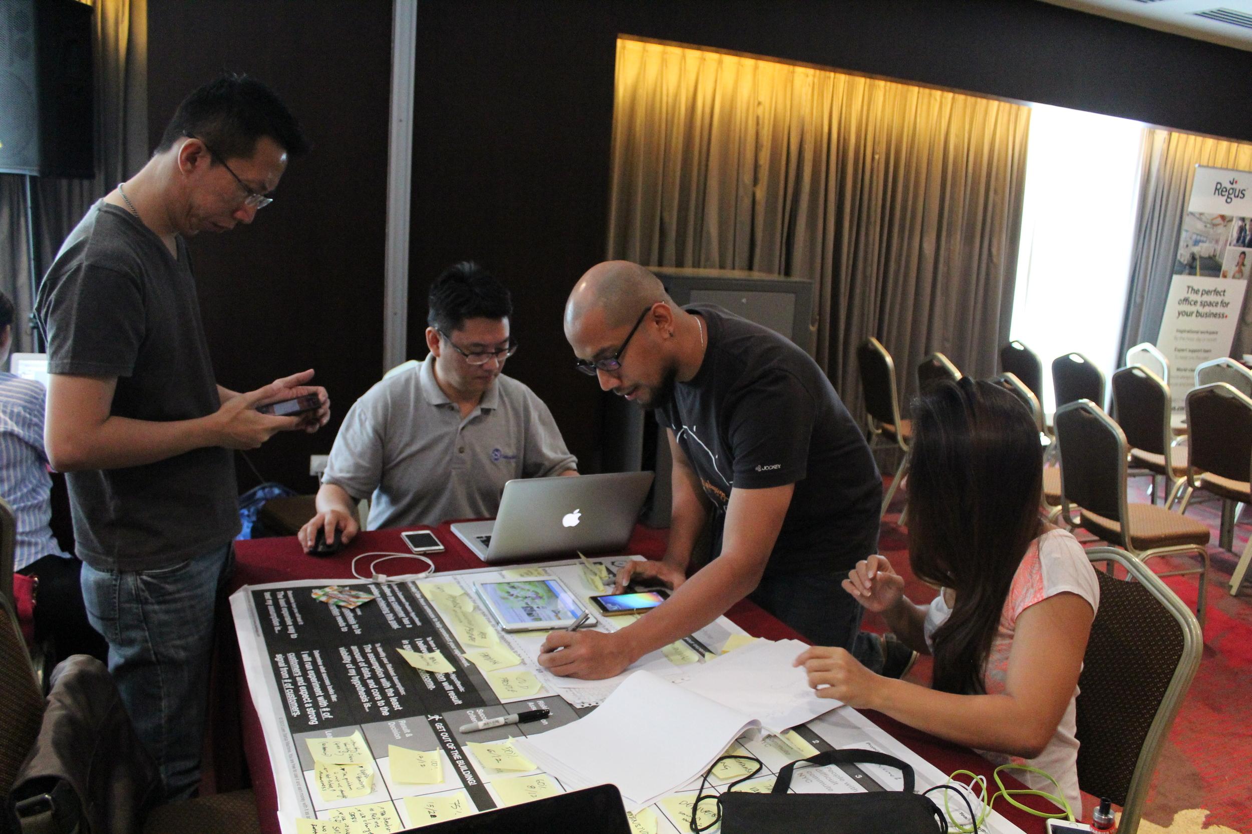 Miao Team working on their Vegetarian Cuisine idea
