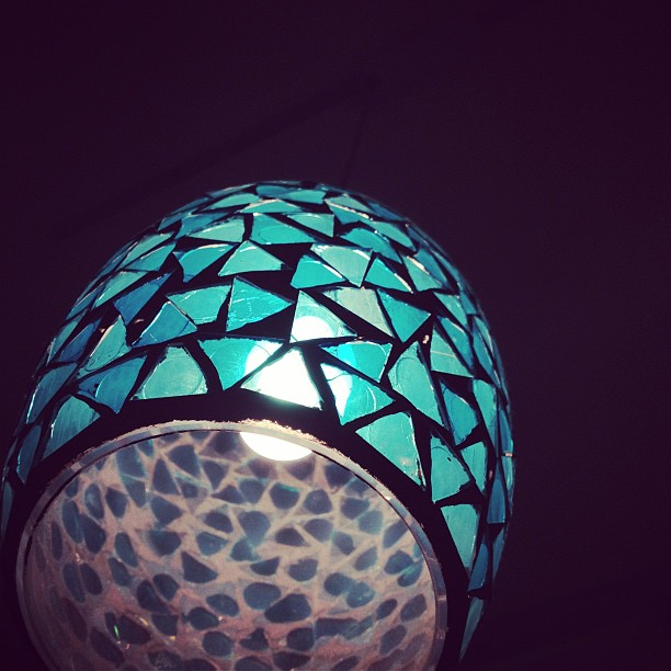 Glass triangles on a lamp.  (Taken with  instagram )