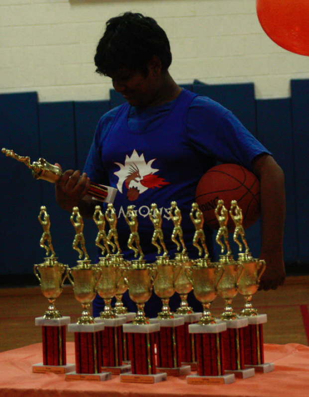 One our kids receiving a trophy for their hard work!