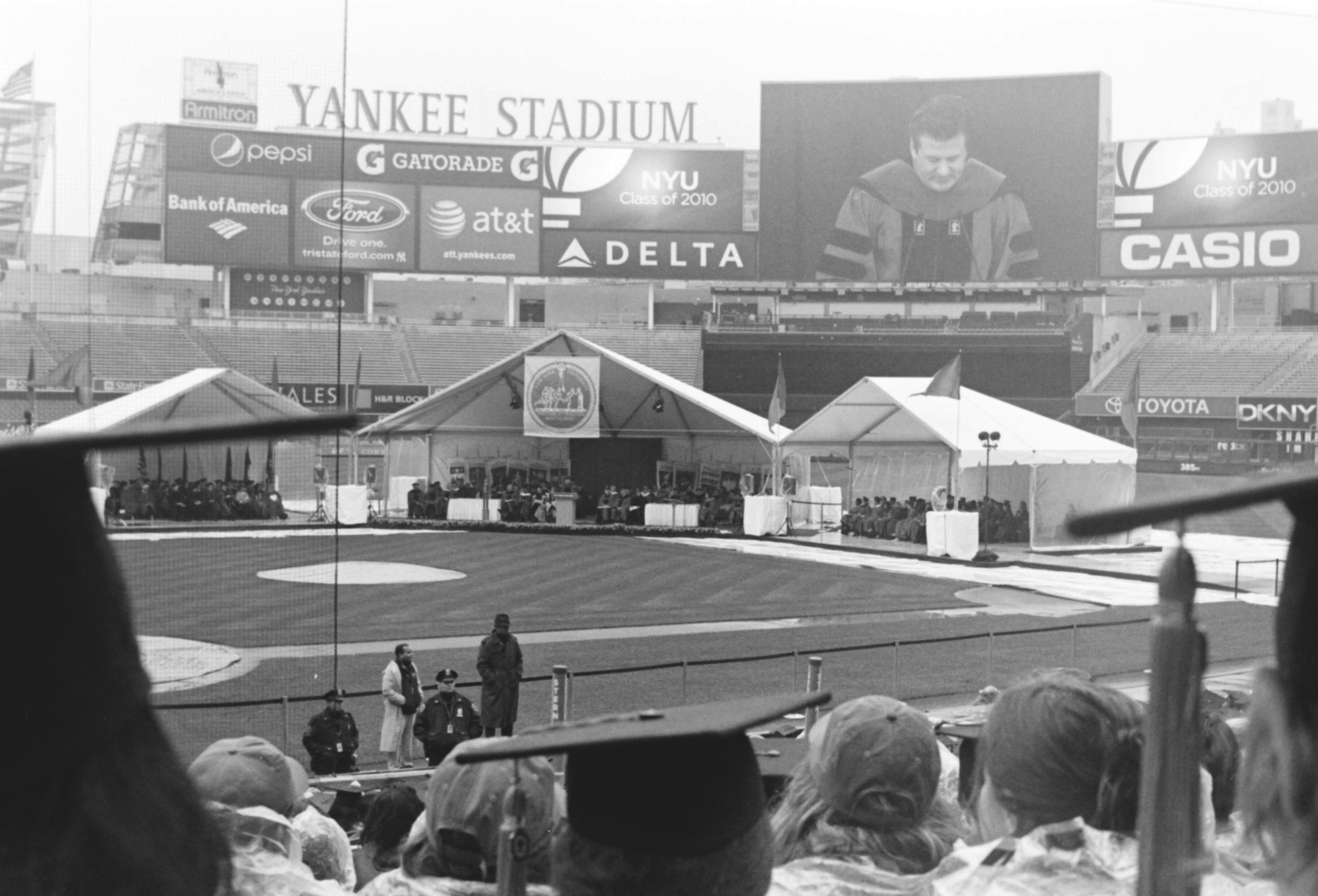 Alec Baldwin speaks in Yankee Stadium  NYU Graduation 2010  35mm b&w film